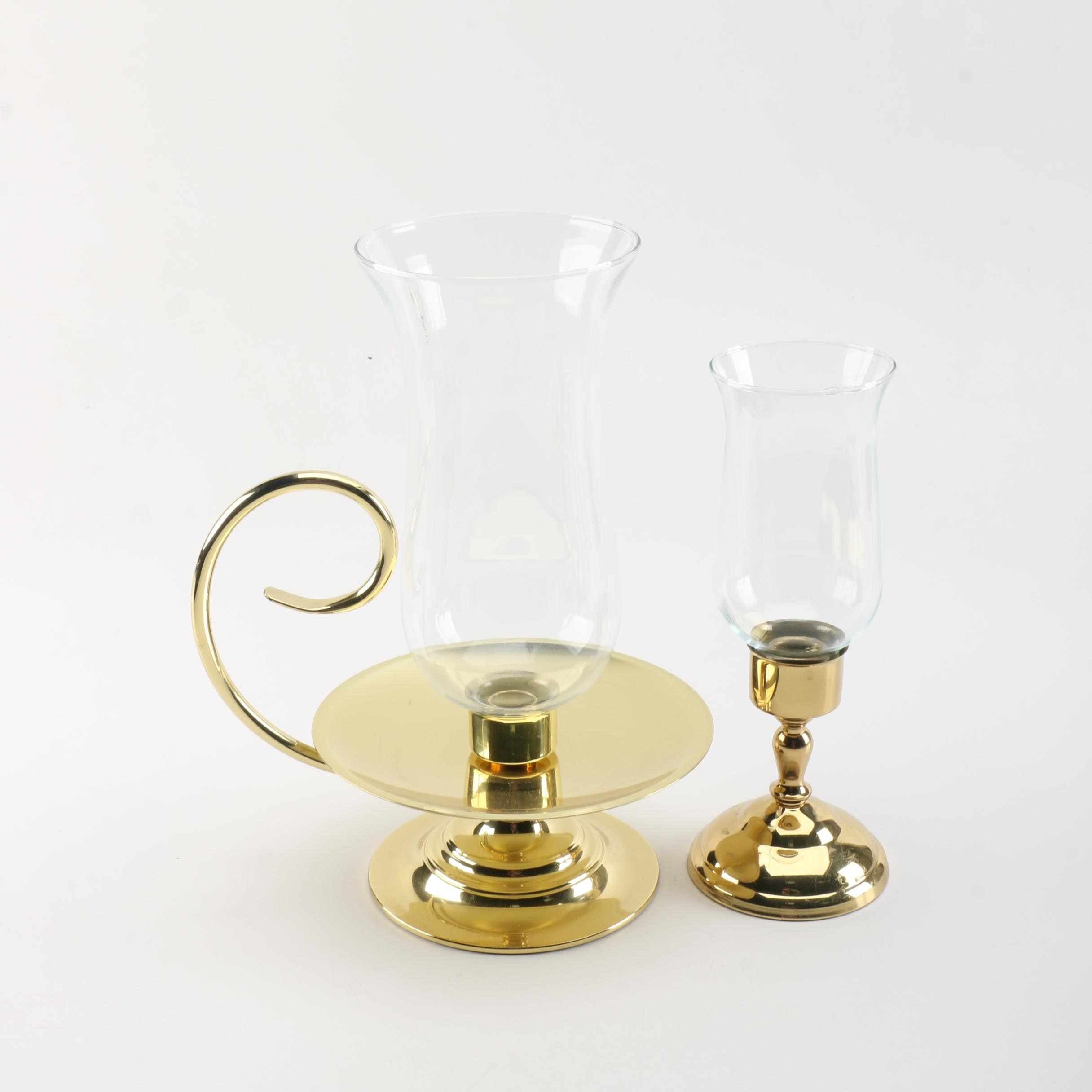 Two Brass and Glass Hurricane Lamps
