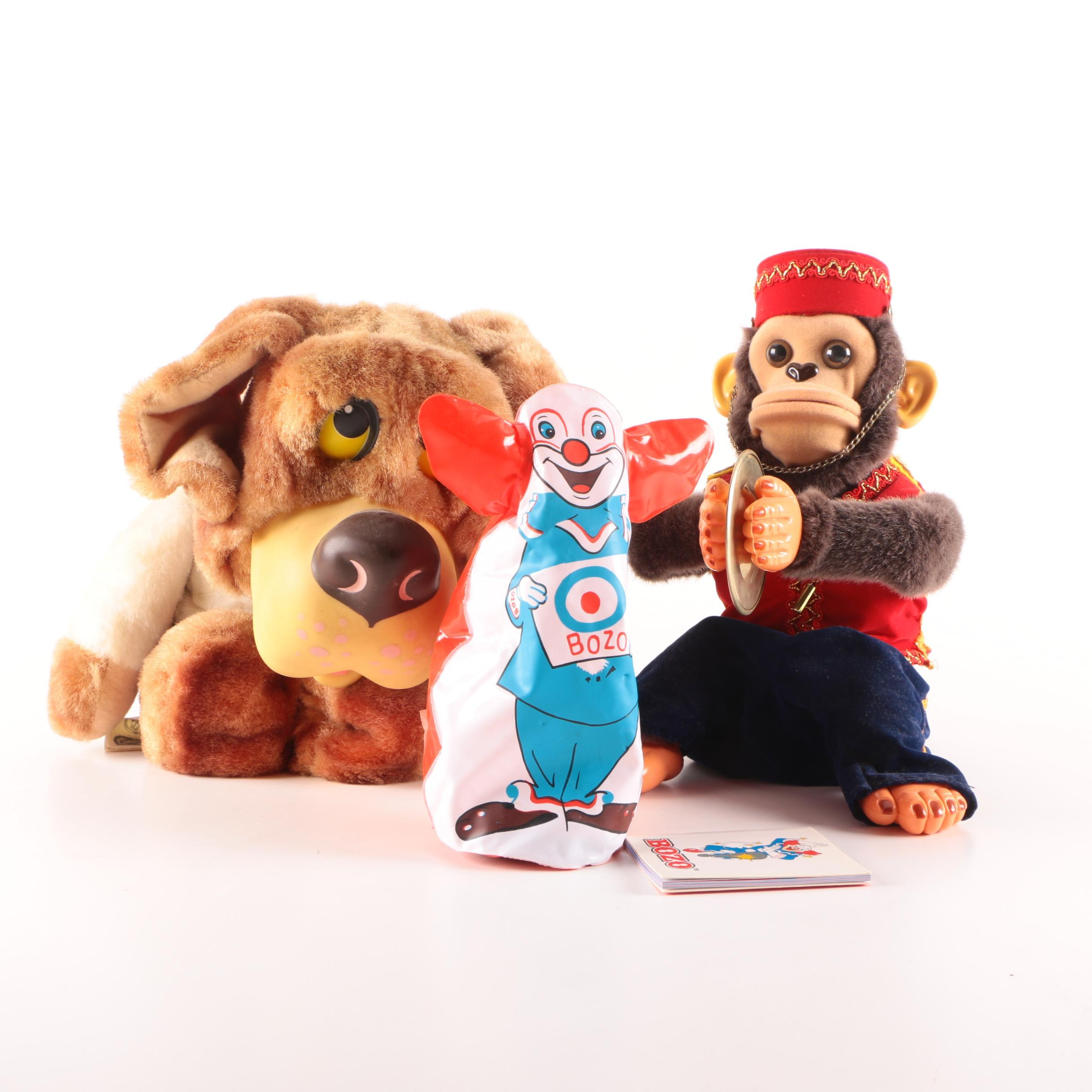 Mister Monkey, Bozo Inflatable Punching Bag, and Talking Bernie Bernard