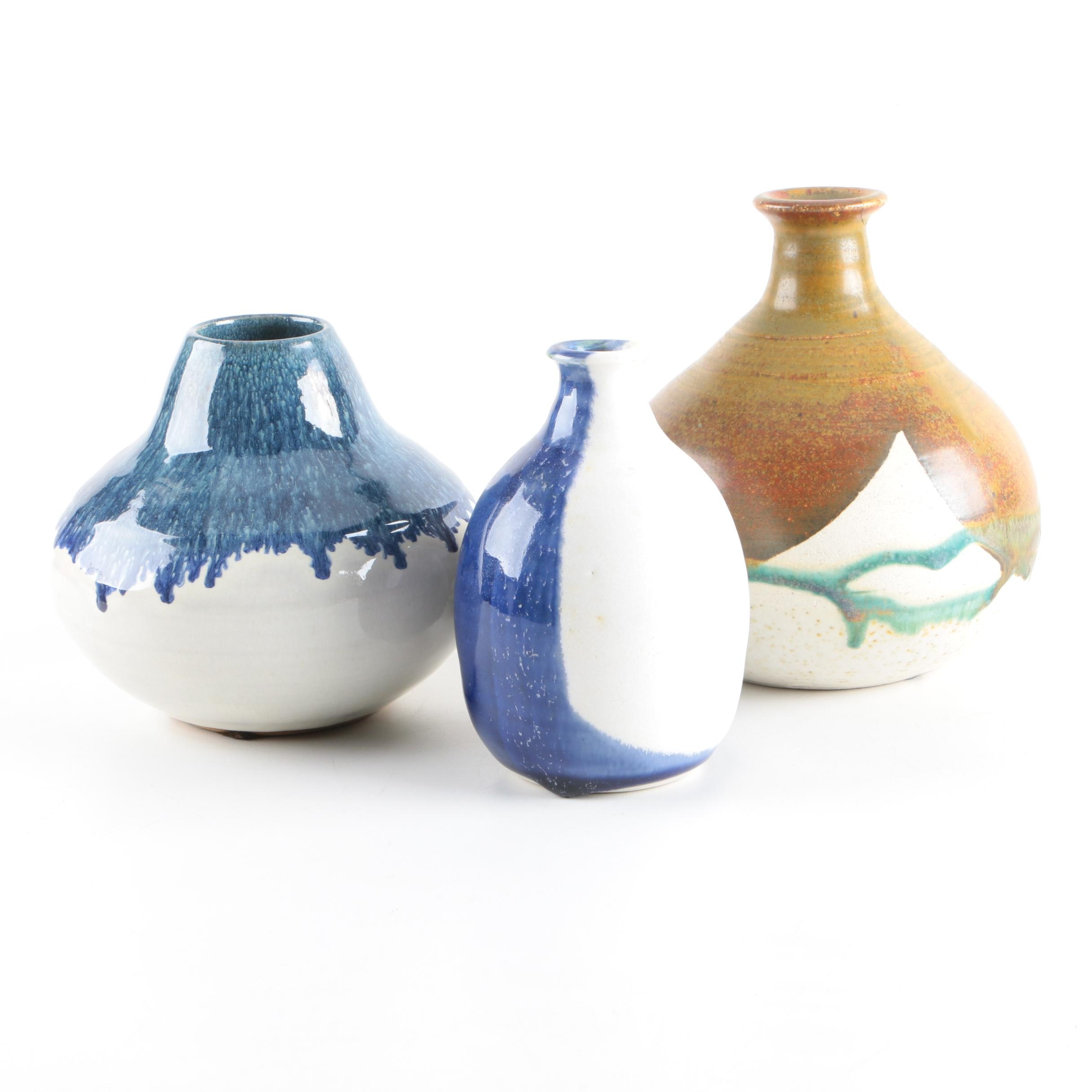 Art Pottery Bottles and a Vase