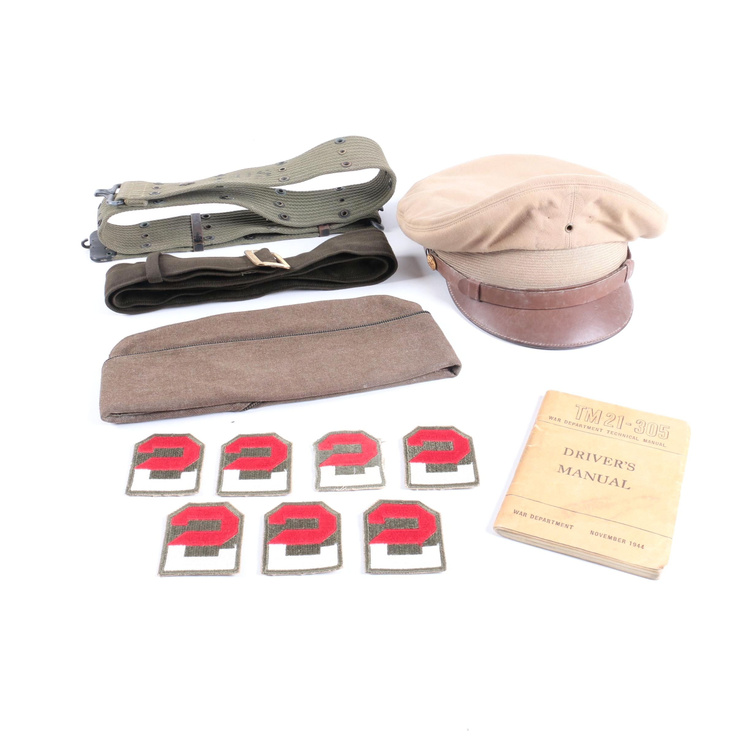 Vintage Military Accessories Including Caps, Belts, Patches, and Driver's Manual