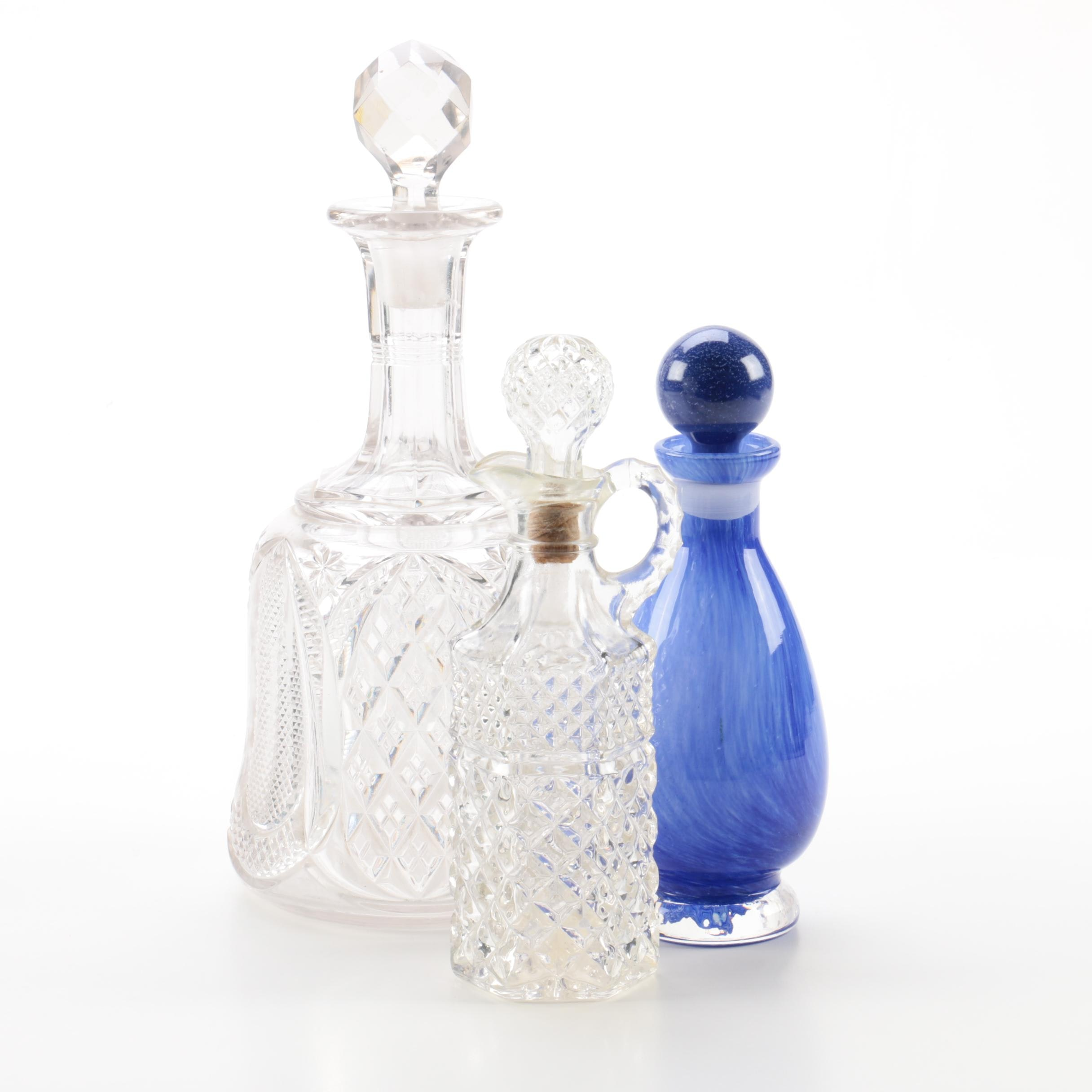 Glass Decanter, Cruet, and Blue Bottle