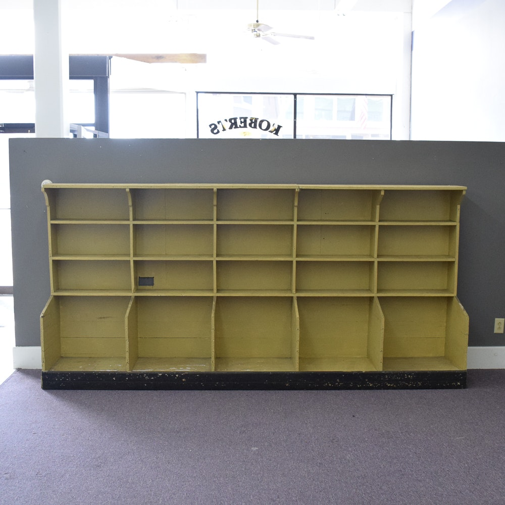 Yellow-Painted Wood Shelving with Cubby Compartments