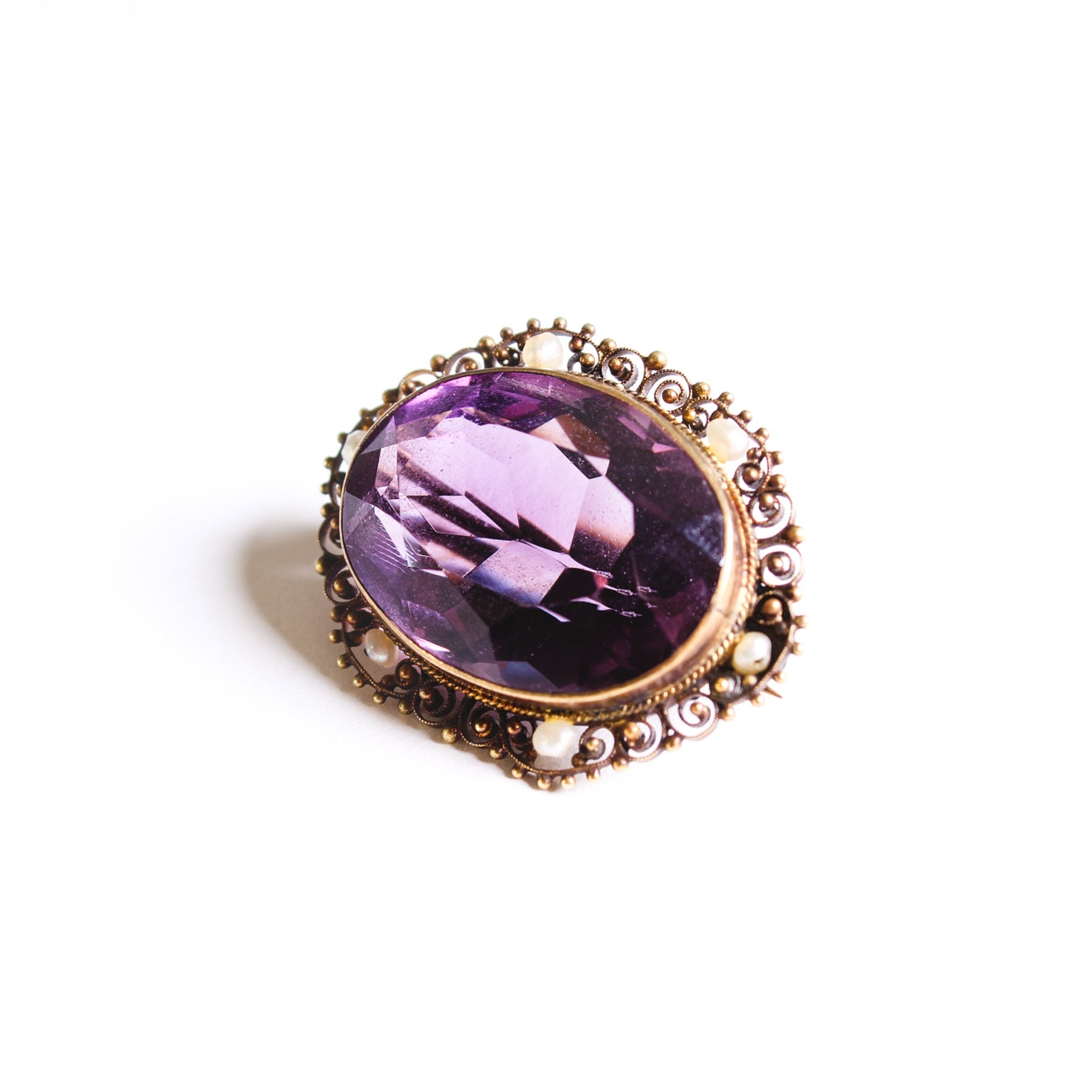 Early 20th Century 14K Yellow Gold 25.28 Carat Amethyst and Seed Pearl Brooch