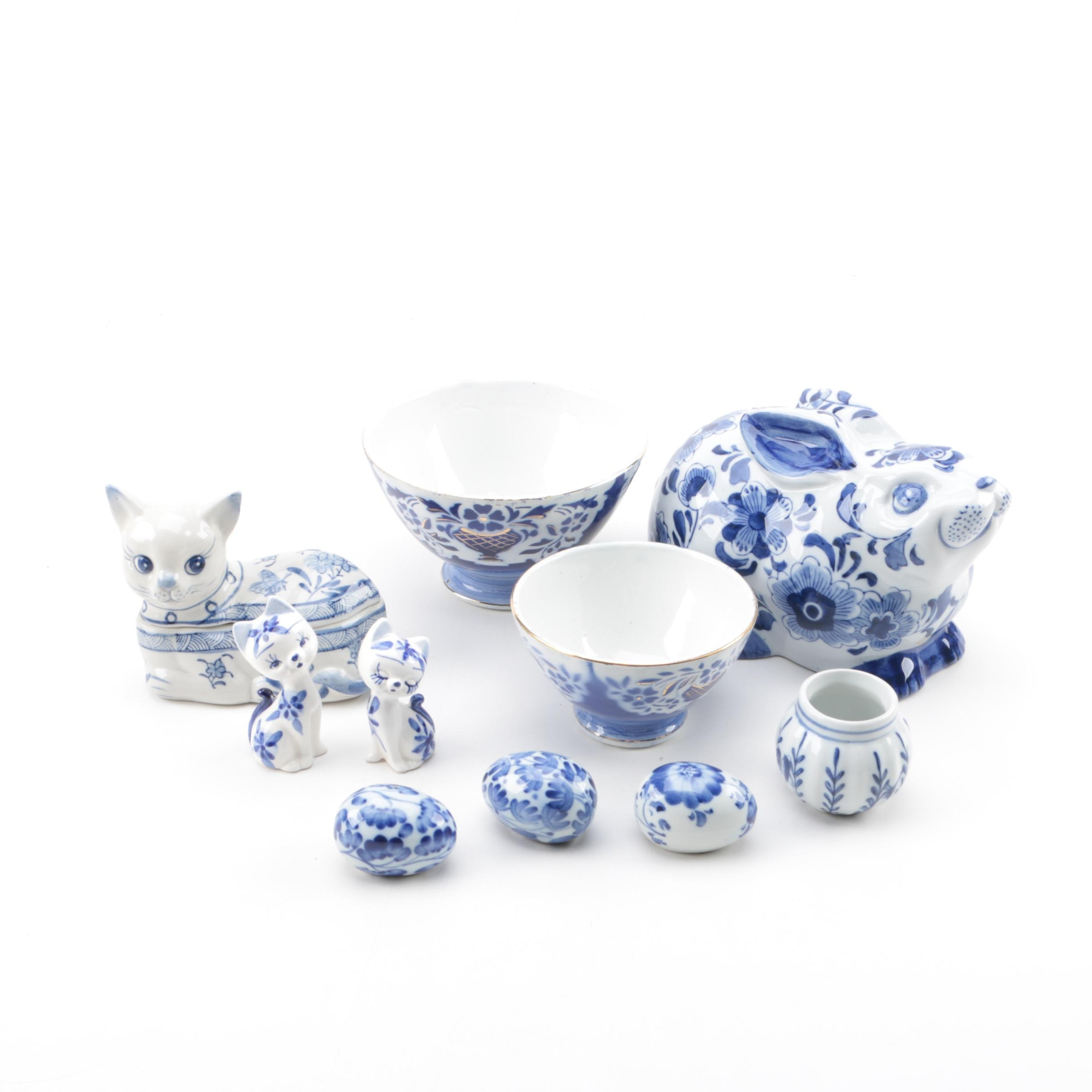 Blue and White Ceramic and Porcelain Bowls, Eggs, Figurines