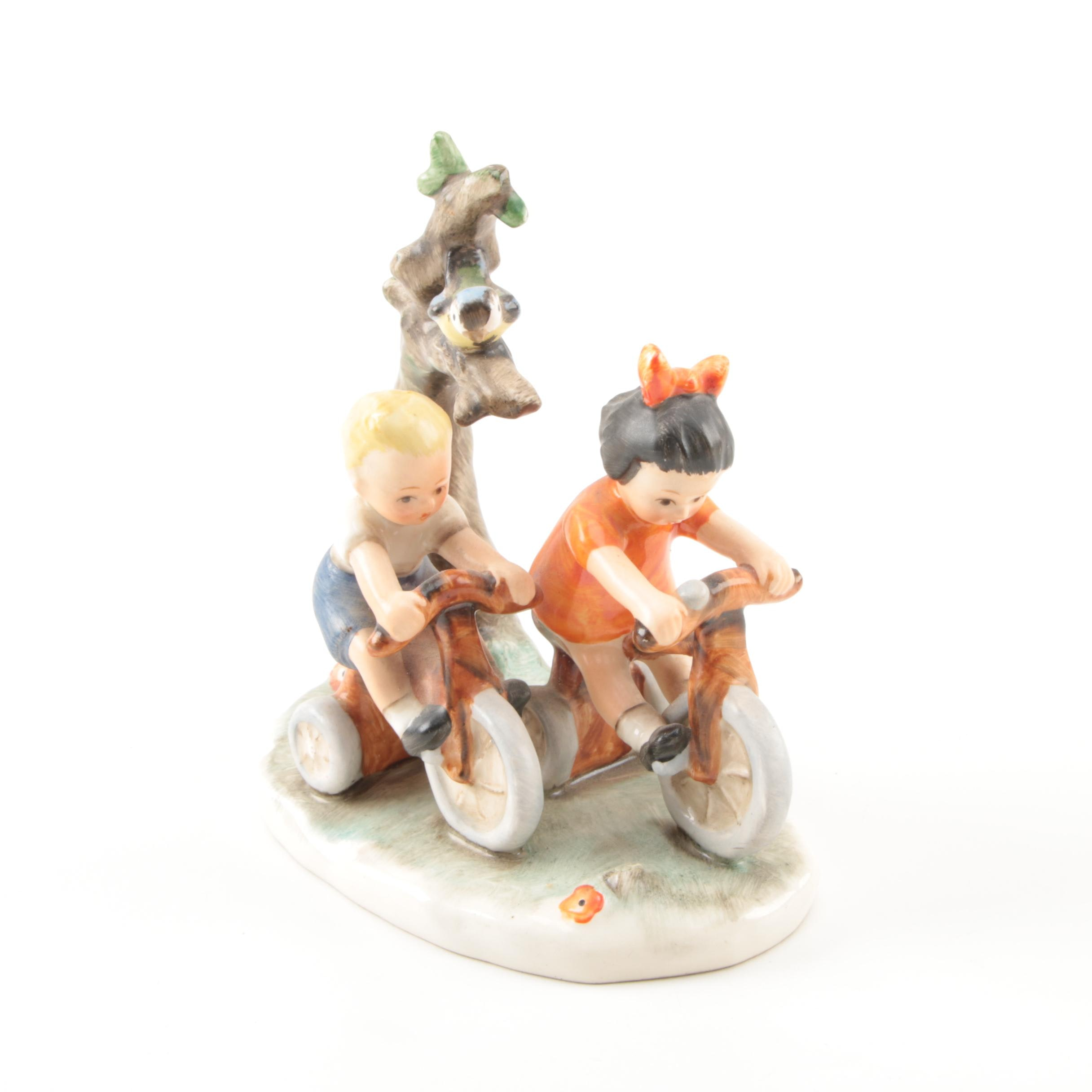 Hand-Painted Goebel Figurine of Children on Bikes