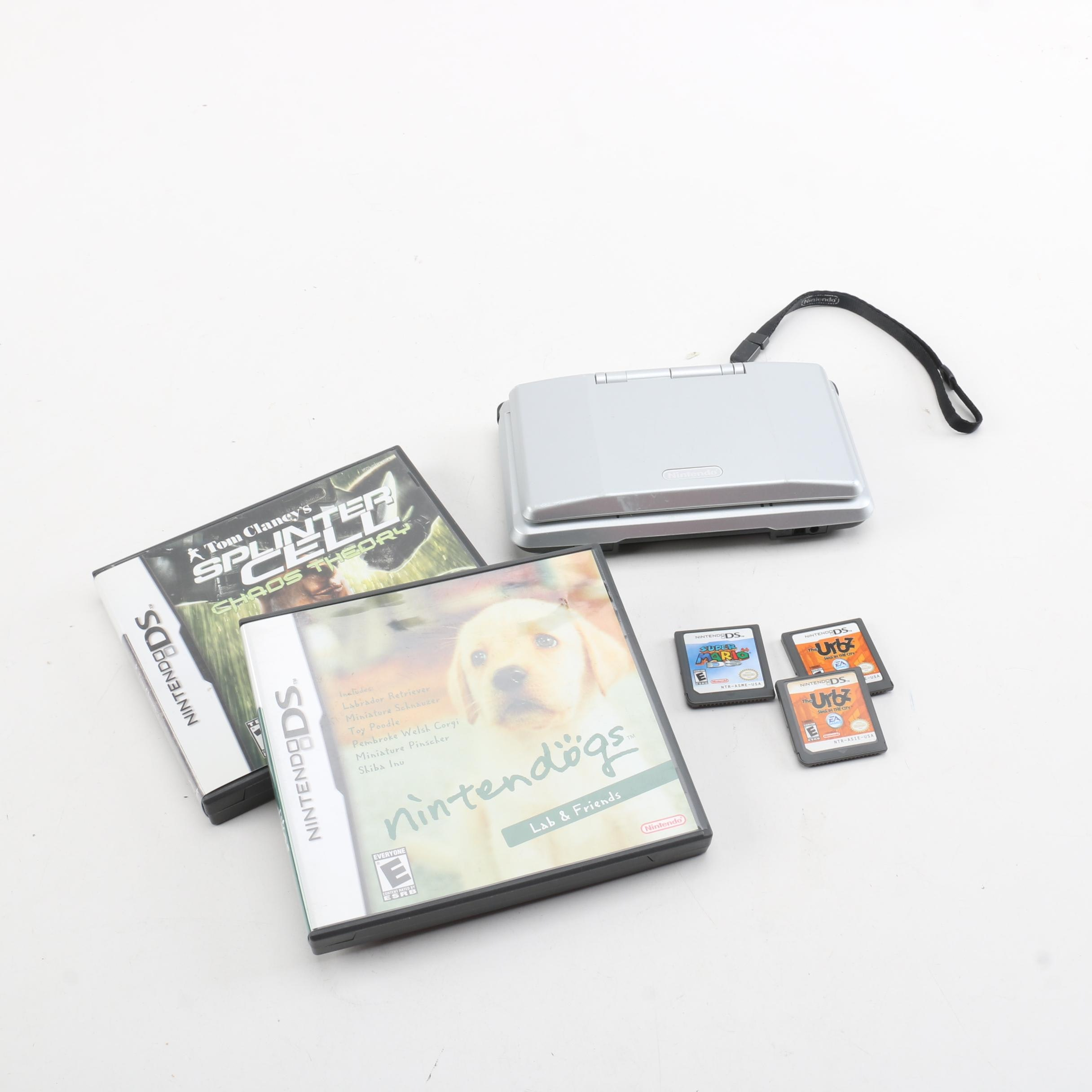 """Nintendo DS with """"Pokémon Black"""" and Other Games"""