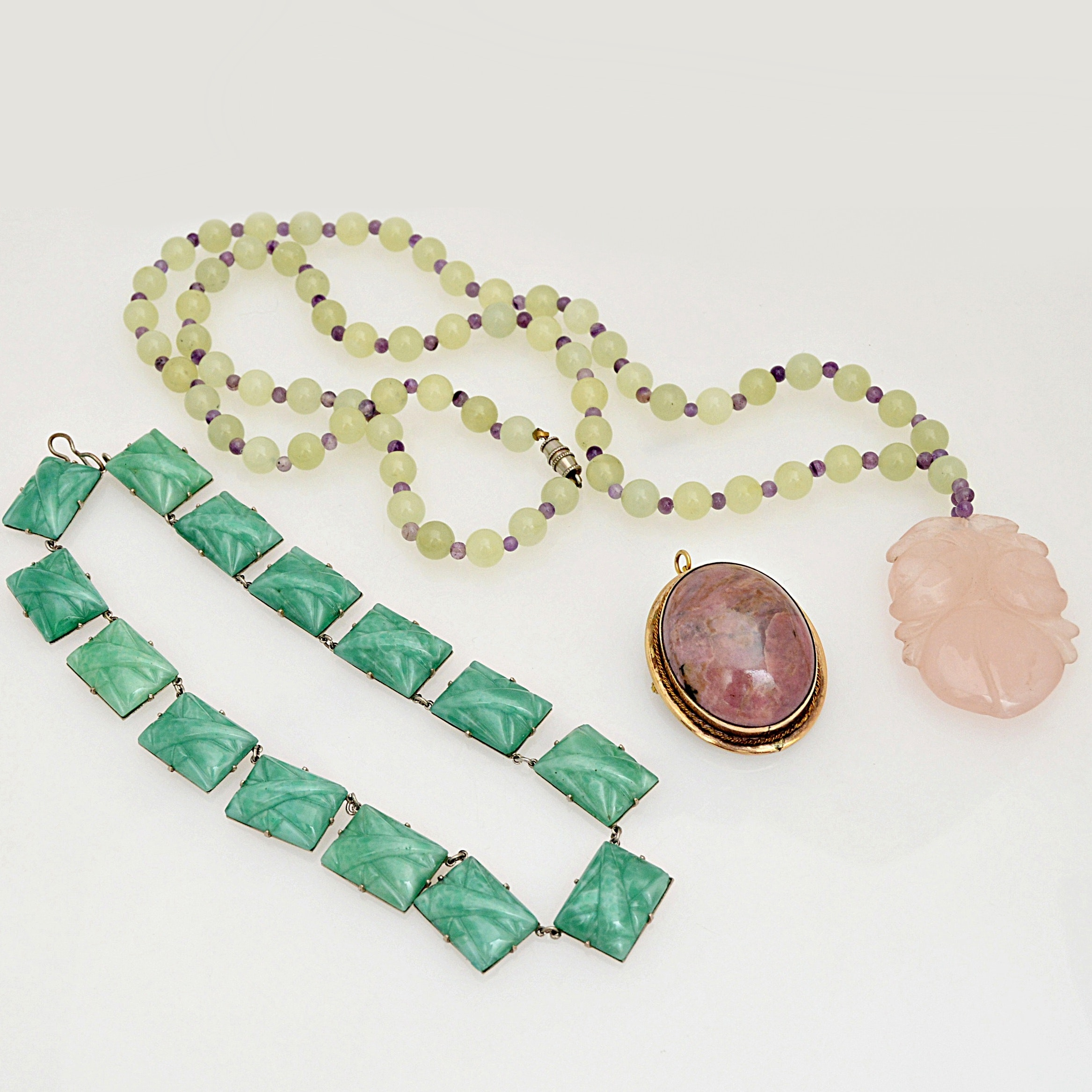 Pendants and Necklaces in Rose Quartz, Amethyst, Rhodonite, Bowenite and Glass