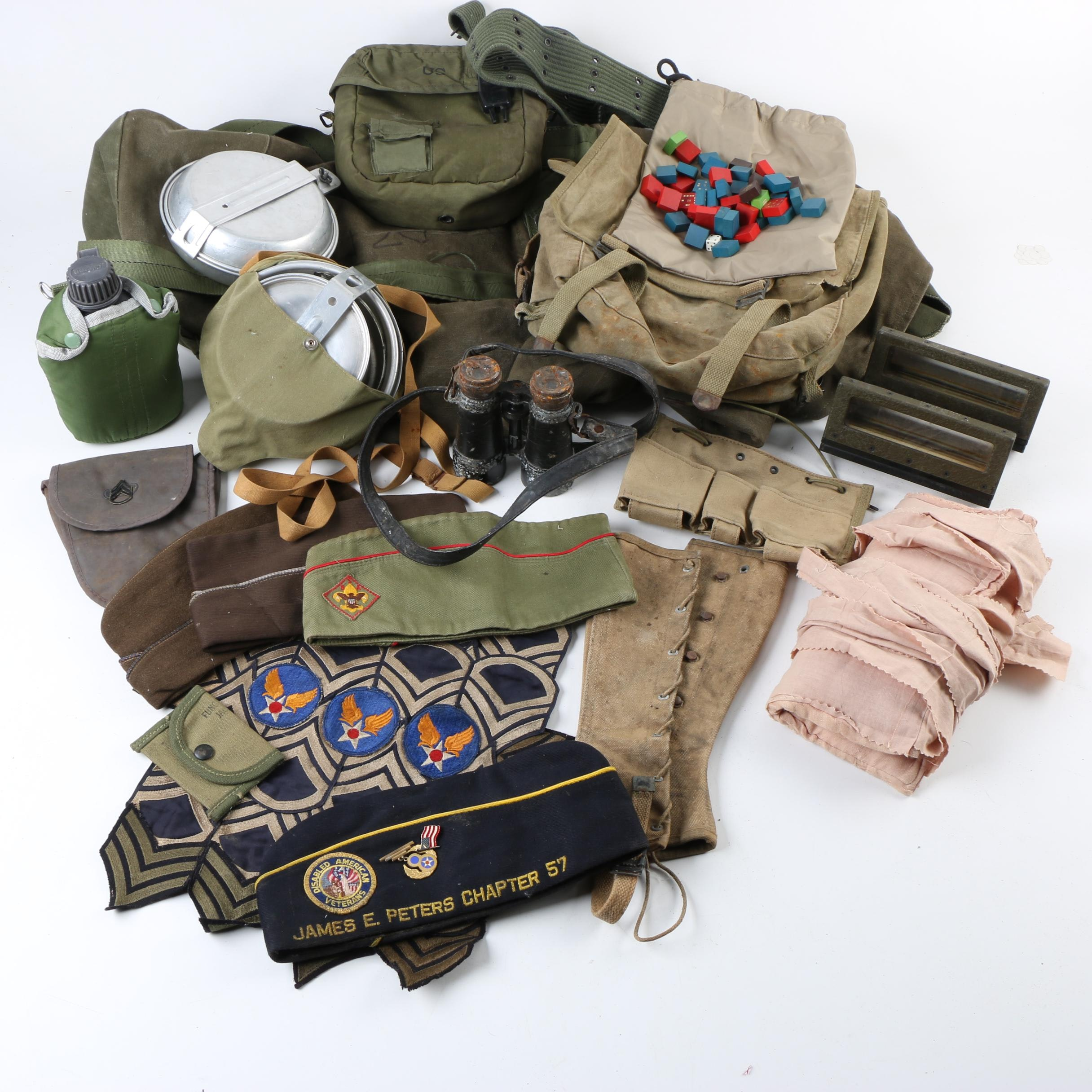 Military Equipment Including Binoculars, Periscope, Packs, and Hats