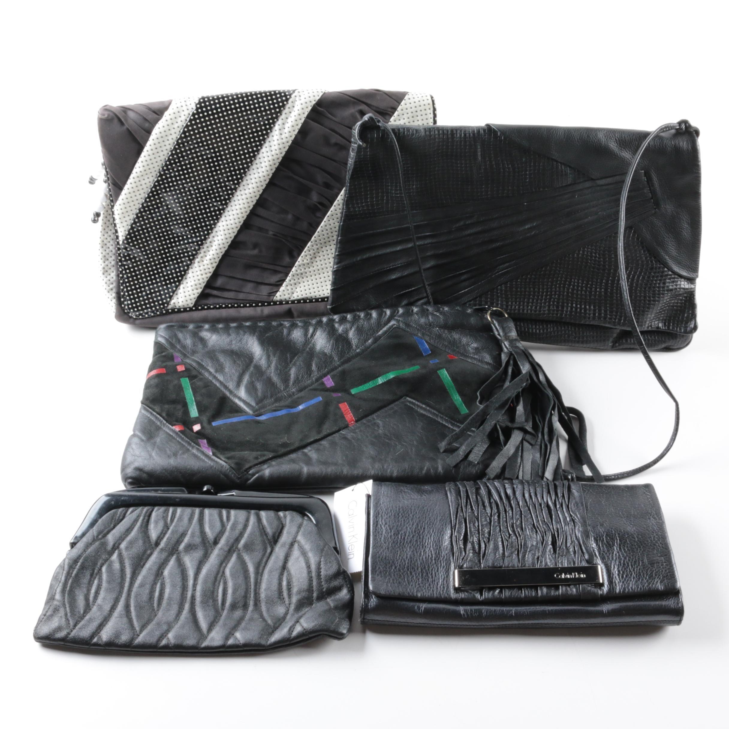 Black Leather Clutches Including Morgan Le Fay and Calvin Klein