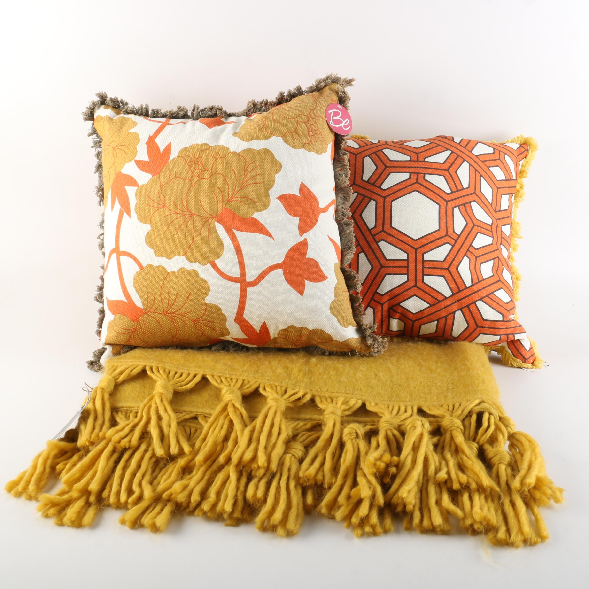 Pairing of Decorative Throw Pillows and Woven Decorative Throw