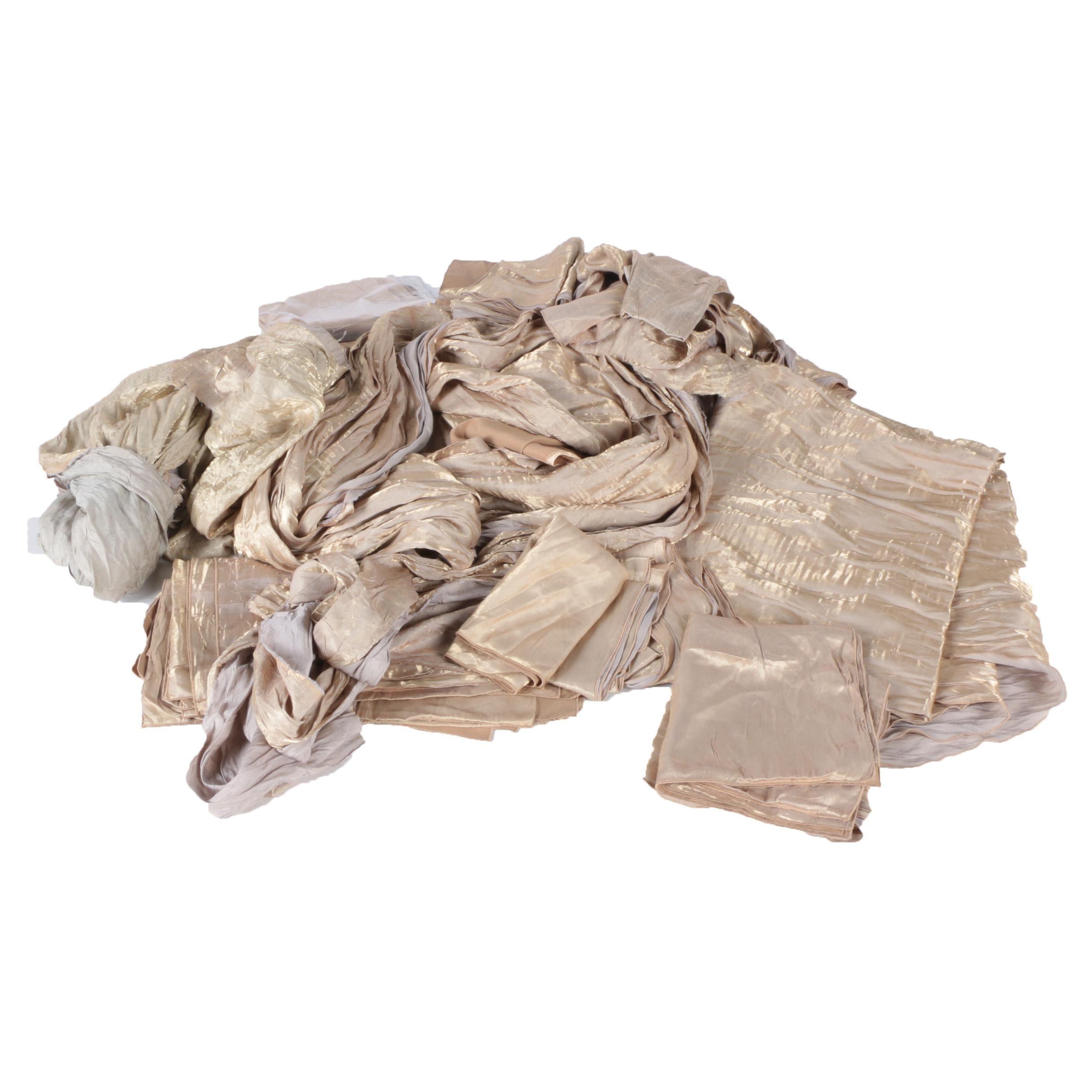 Assortment of Gold-Toned Tablecloths & Napkins
