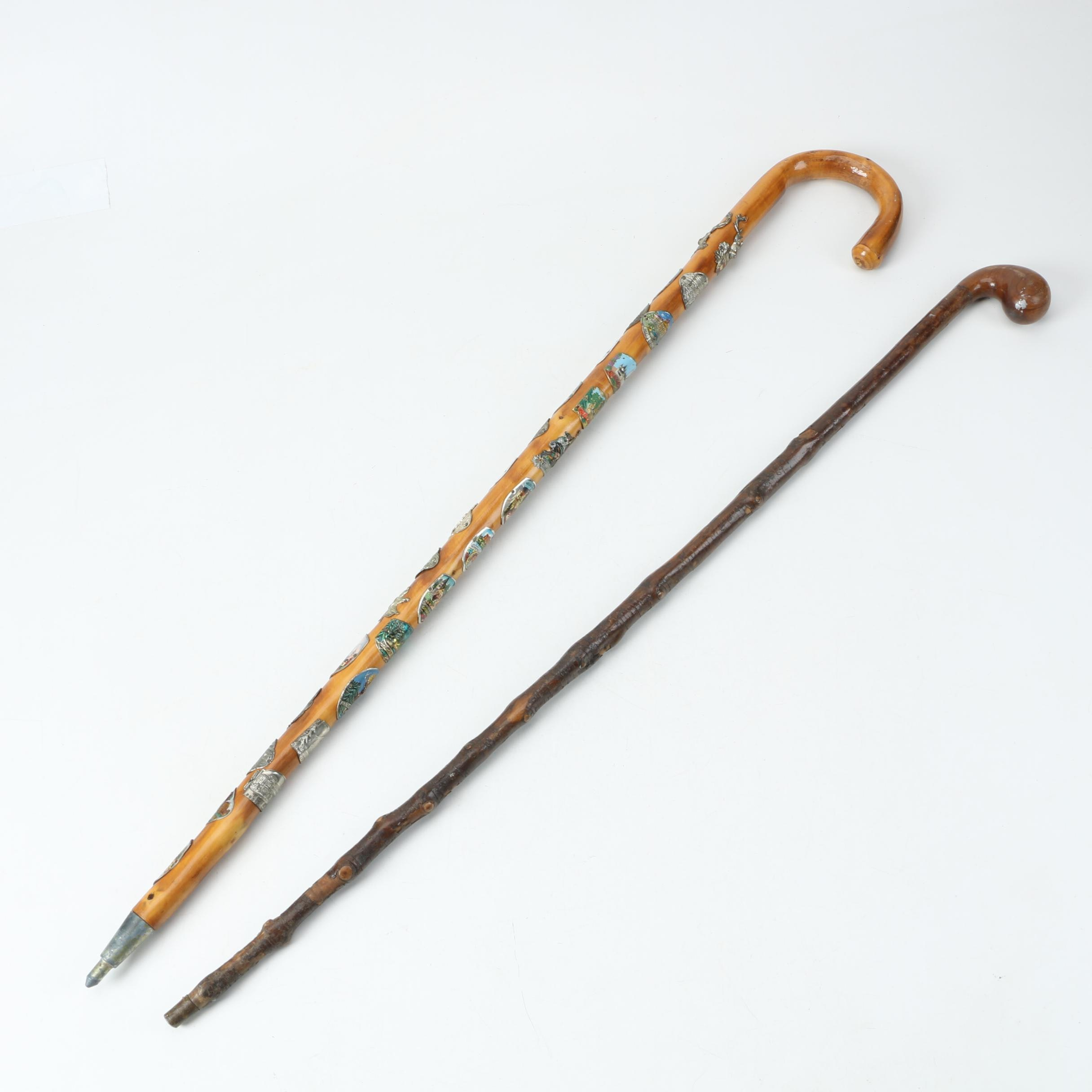 Pair of Wooden Canes Including German and Austrian Landmark Crook-Handled Cane