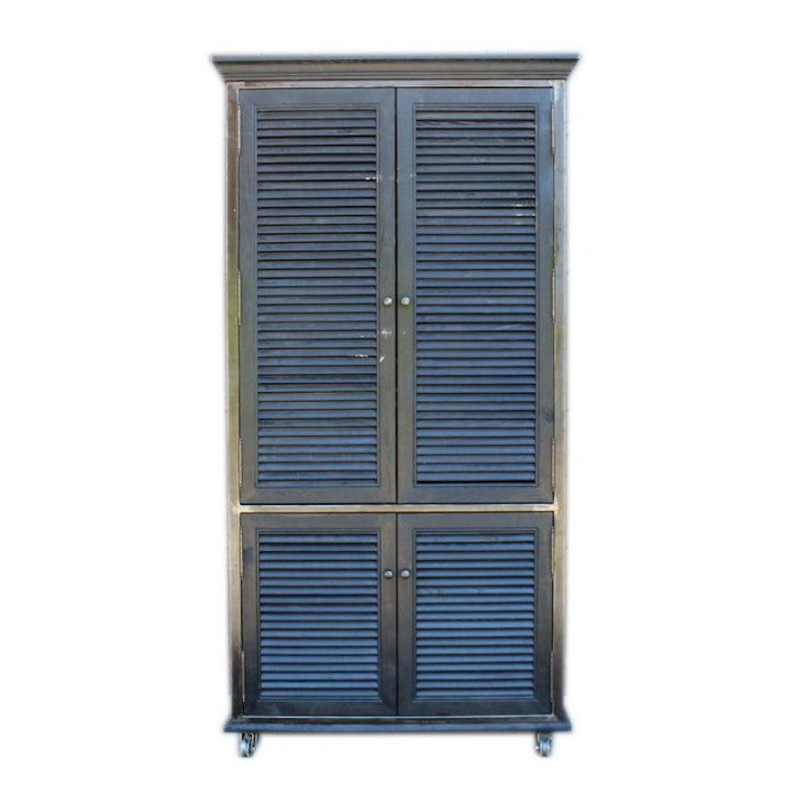 Plantation Style Cabinet With Louvered Doors And Casters Ebth