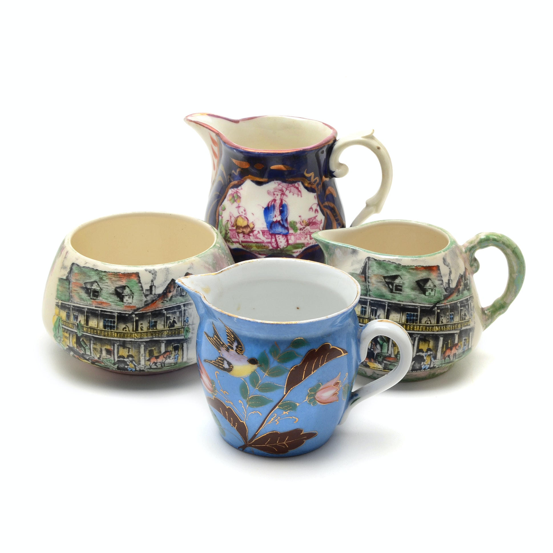 Collection of Porcelain and Pottery Pitchers and Sugar Bowl