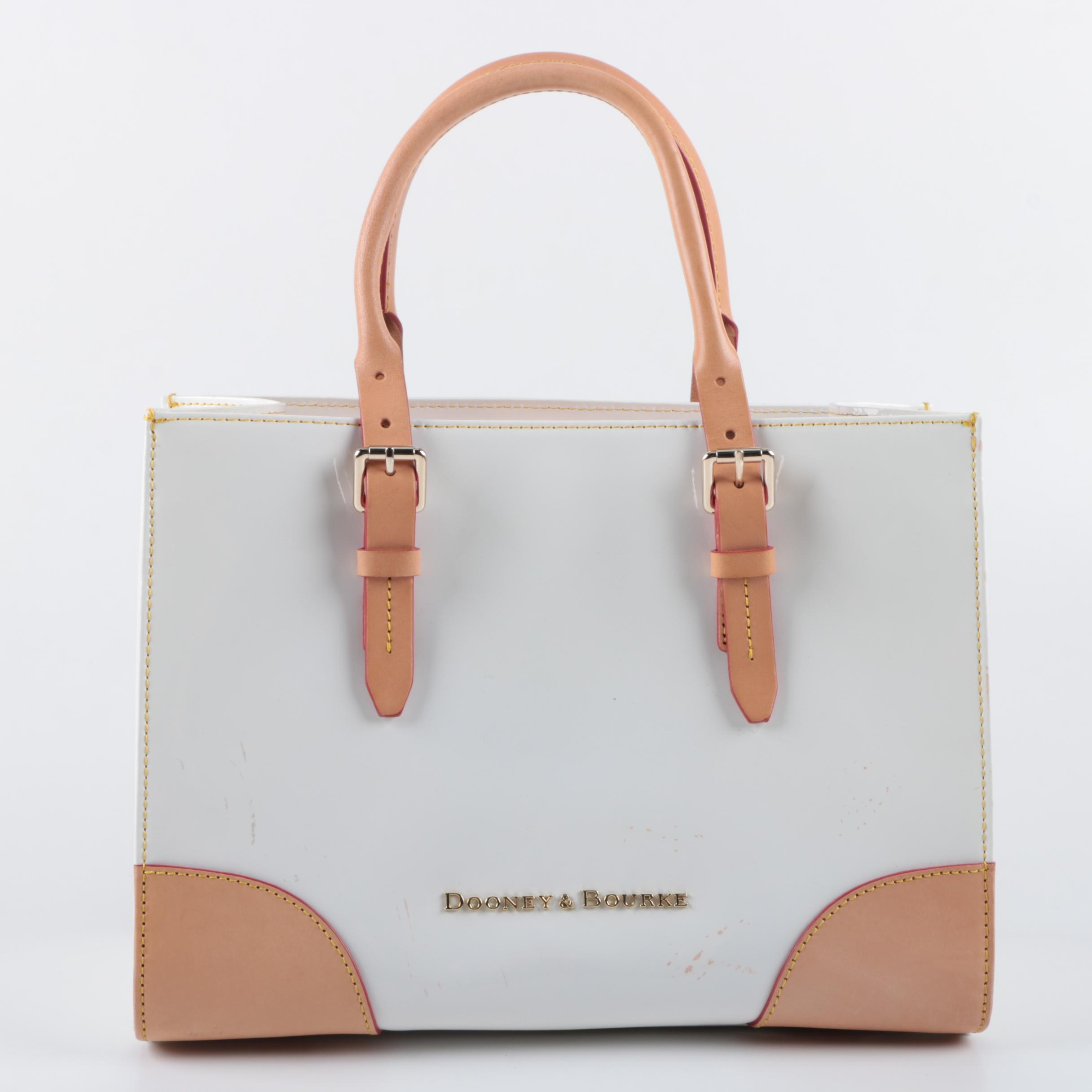 Dooney & Bourke White Patent Leather and Tan Leather Buckle Strap Tote