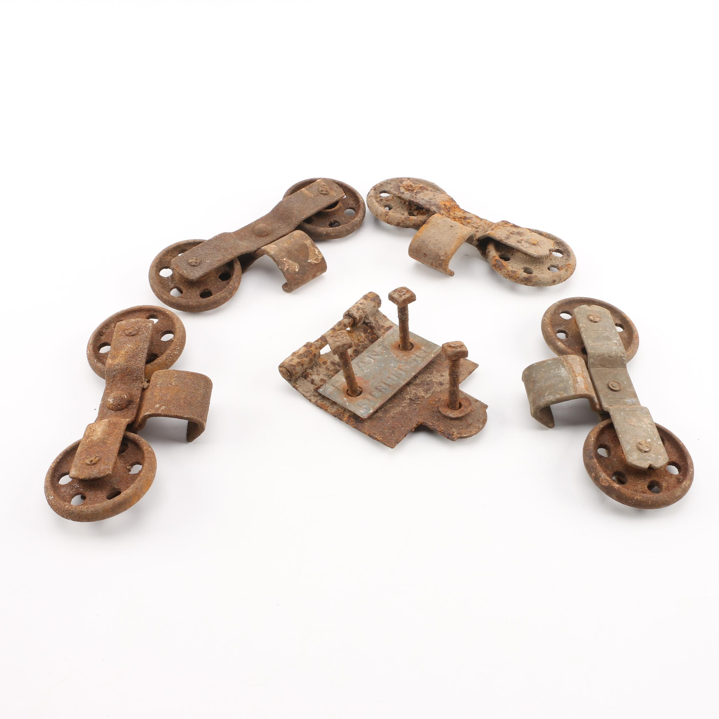 Four Cast Iron Sets of Wheels