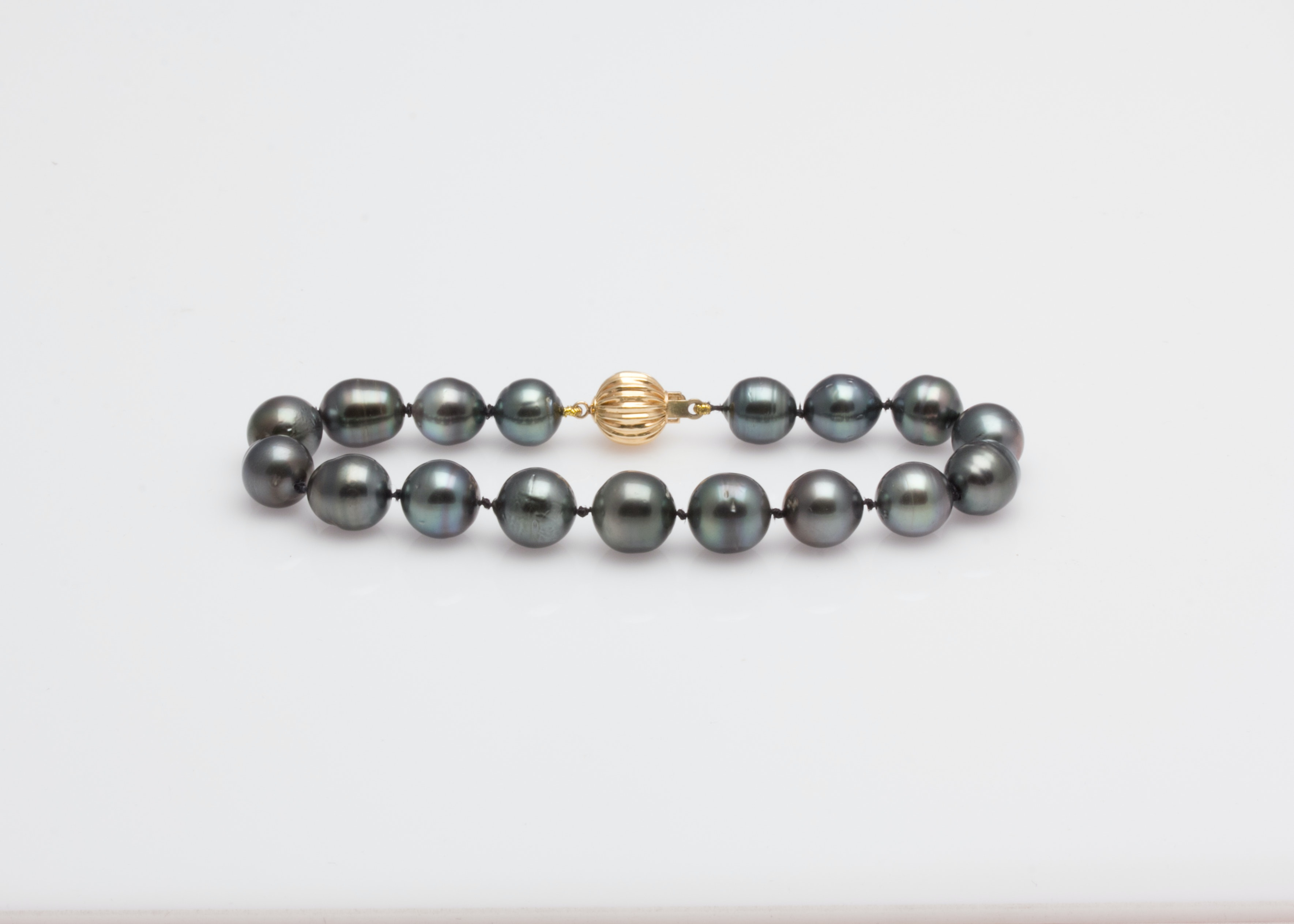 Black Pearl Bracelet with 14K Yellow Gold Clasp