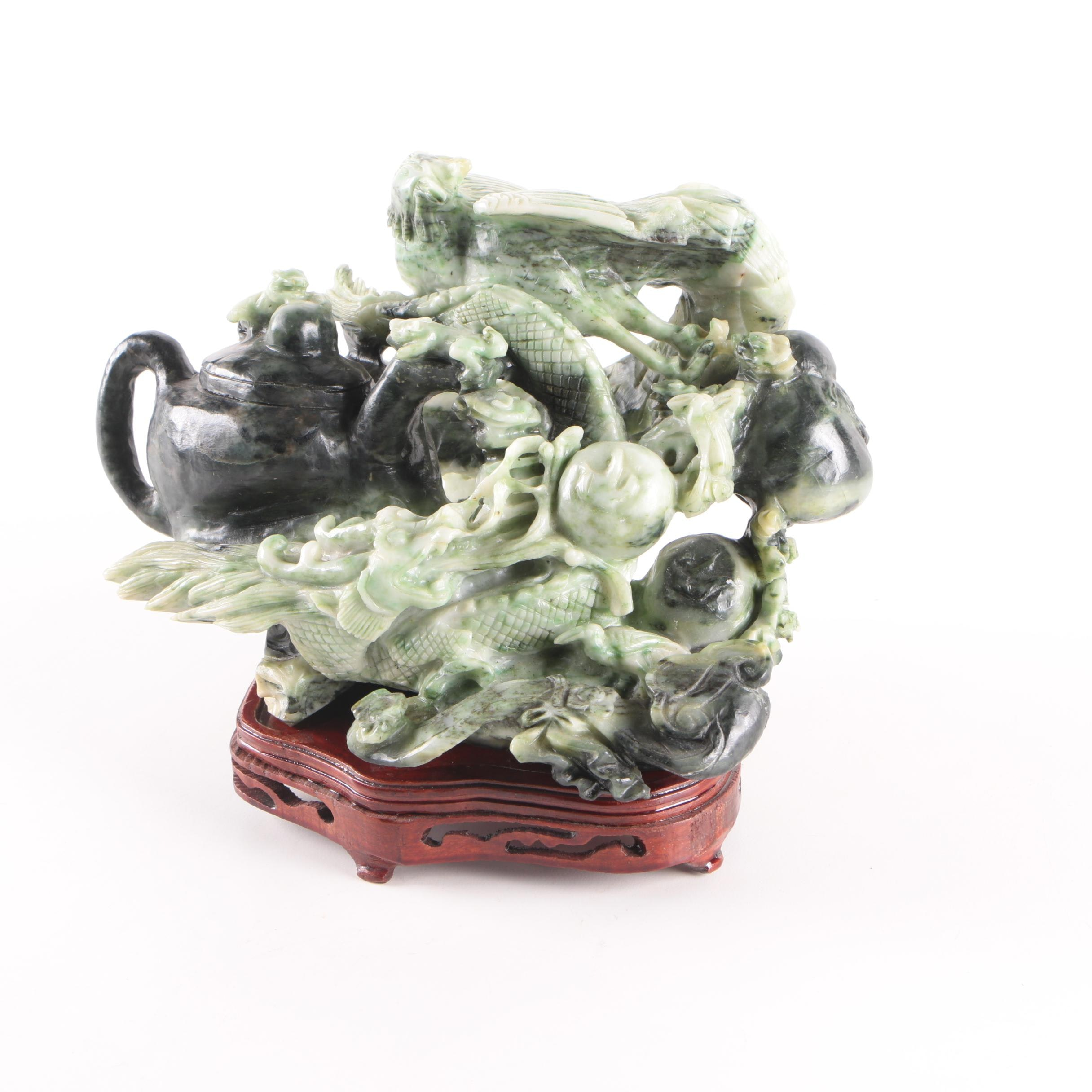 Chinese Serpentine Carving of Dragons With A Teapot On Wood Base