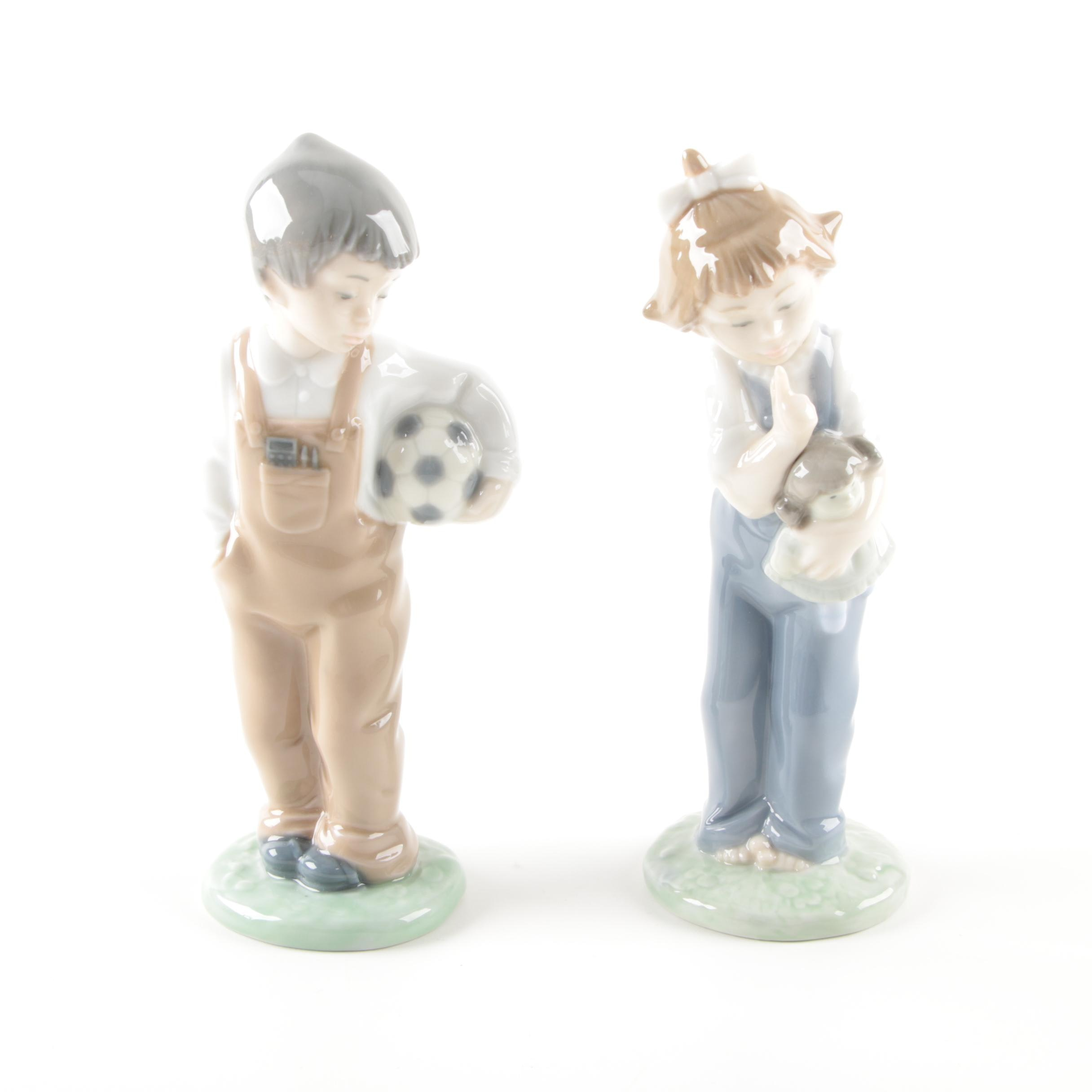 "Lladró ""Boy with Ball"" and ""Girl with Doll"" Porcelain Figurines"