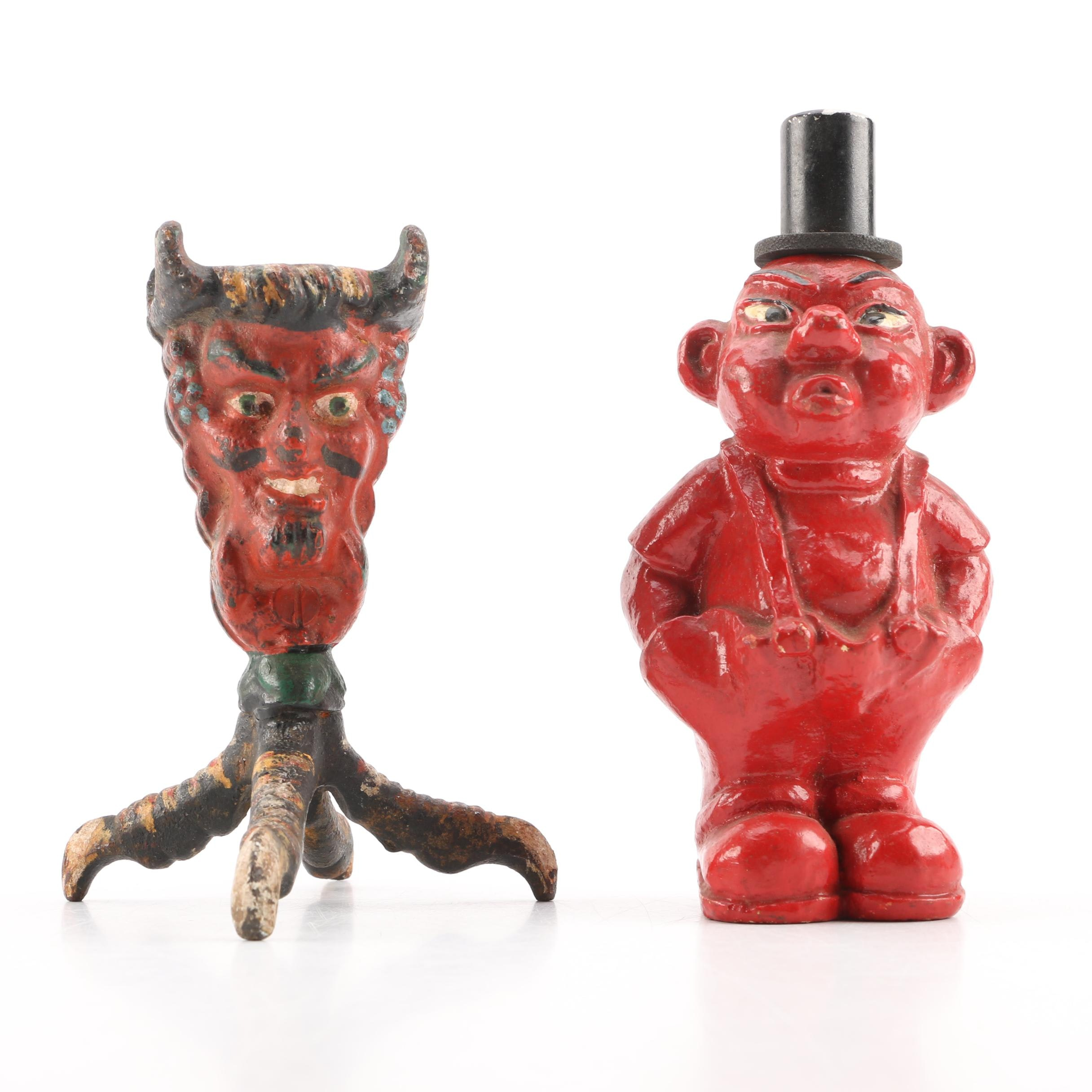 Figural Devil's Head Chicken Foot Match Holder with a Figural Lighter