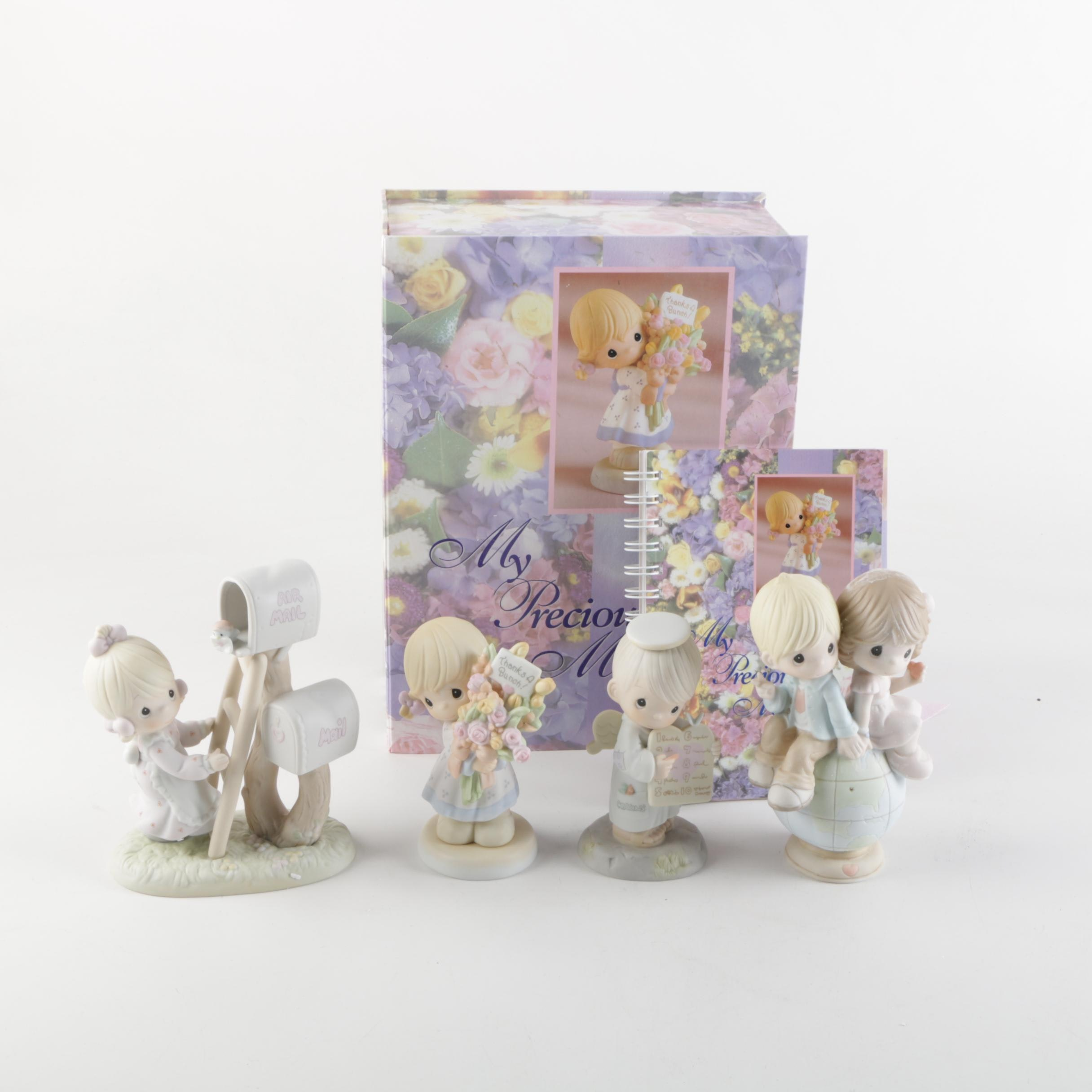 Precious Moments Figurines with a Box and Booklet
