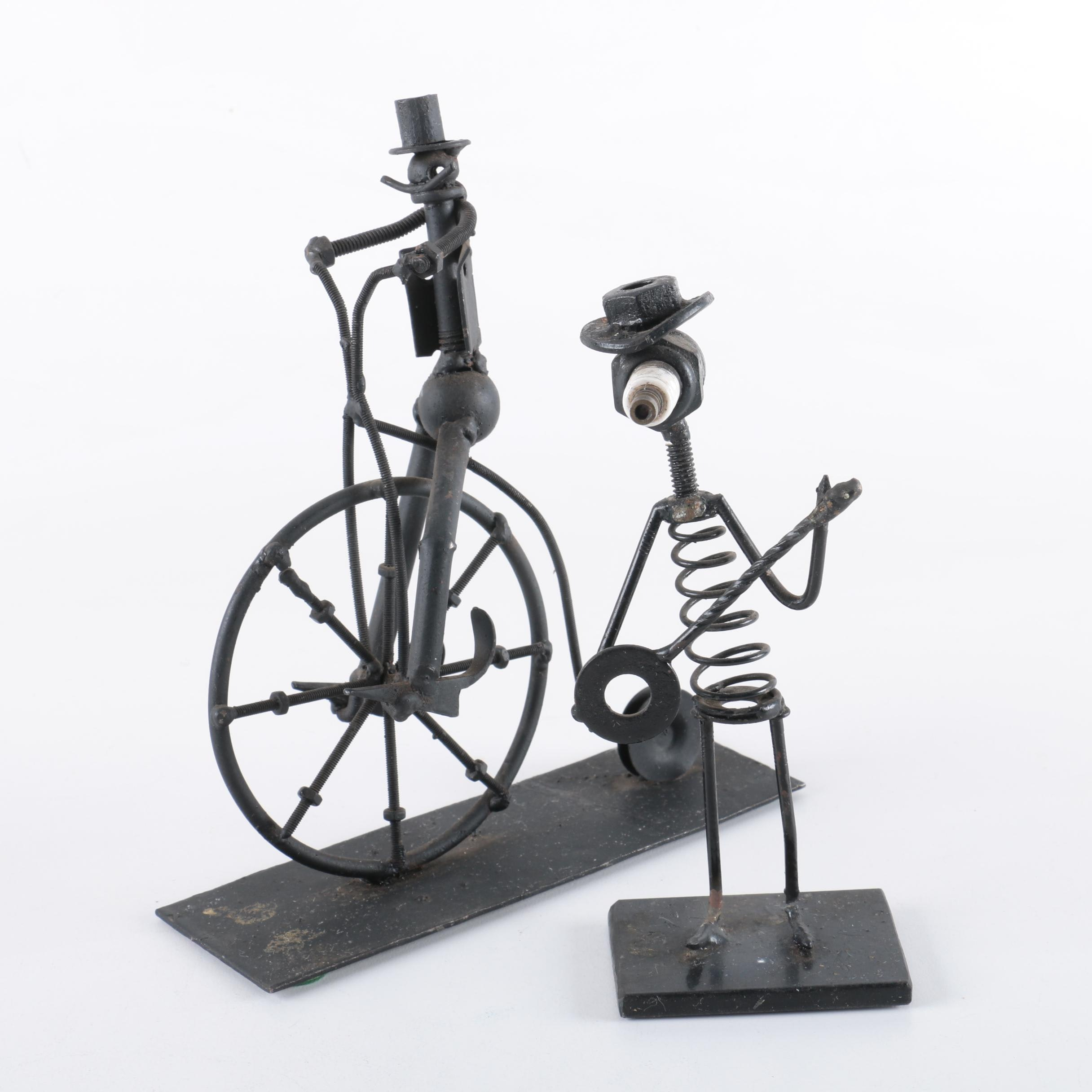 Metal Figurines One on a Vintage Bicycle the Other Playing a Banjo
