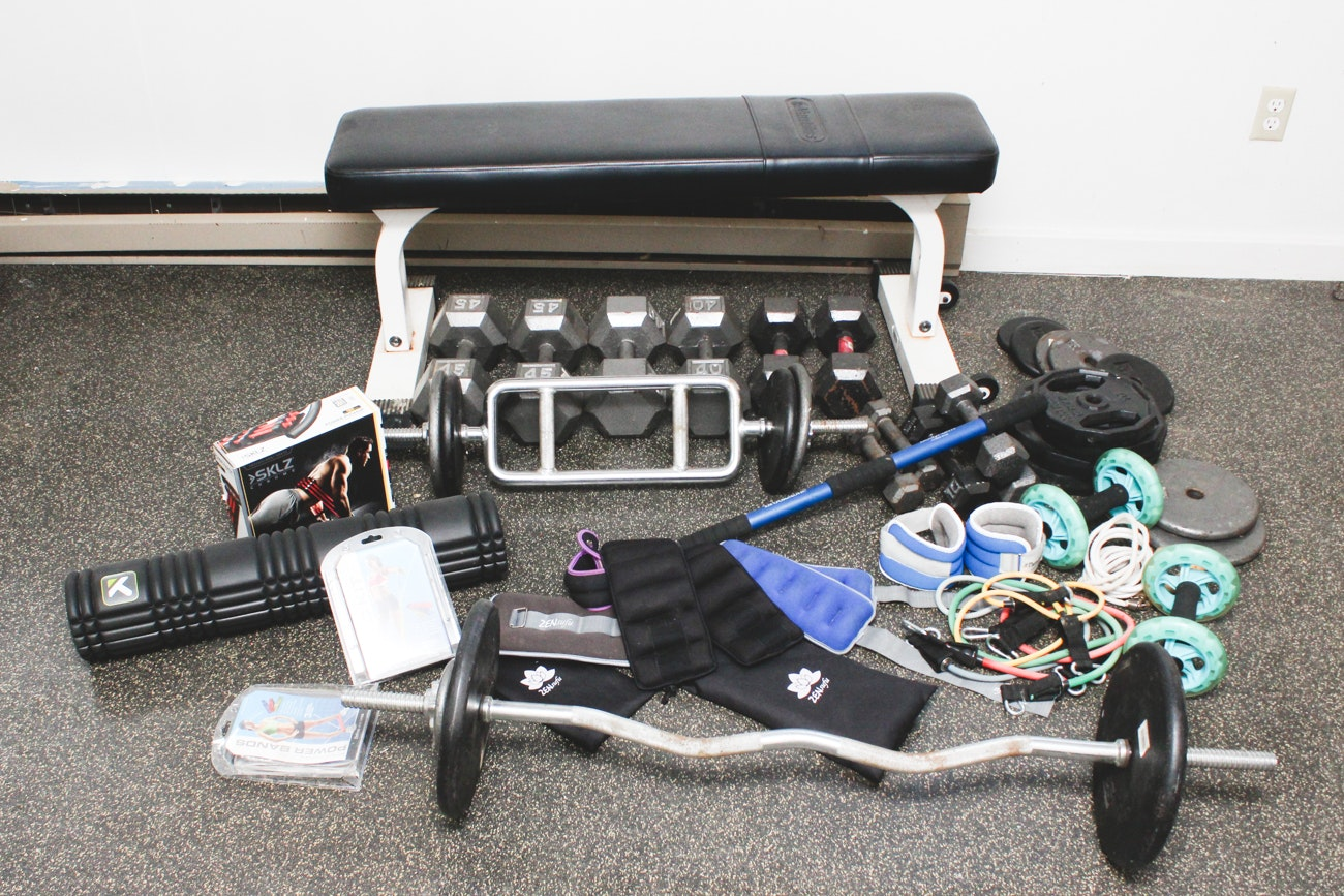 Nautilus Bench, Assorted Weights and Workout Accessories