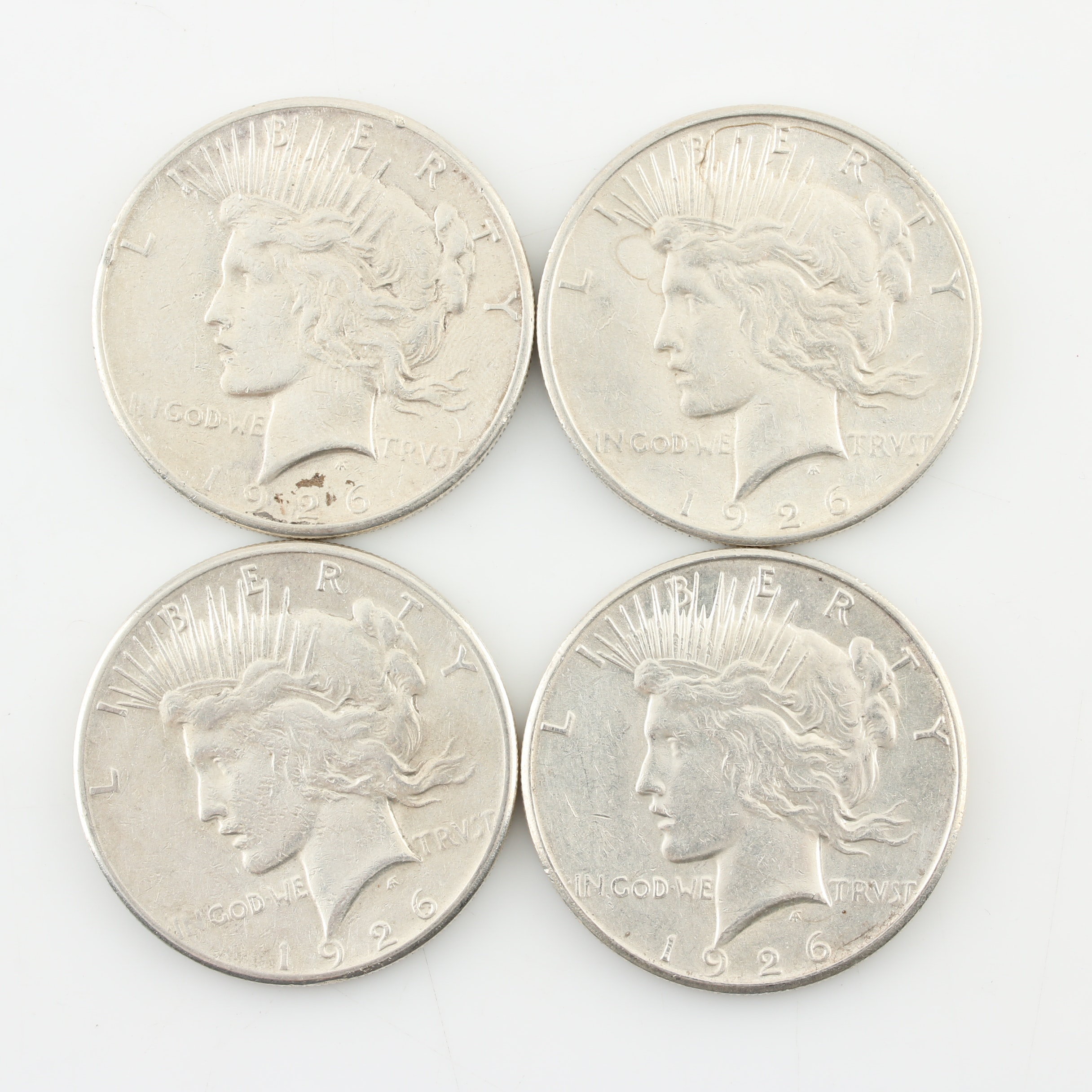 Four 1926-S Peace Silver Dollars