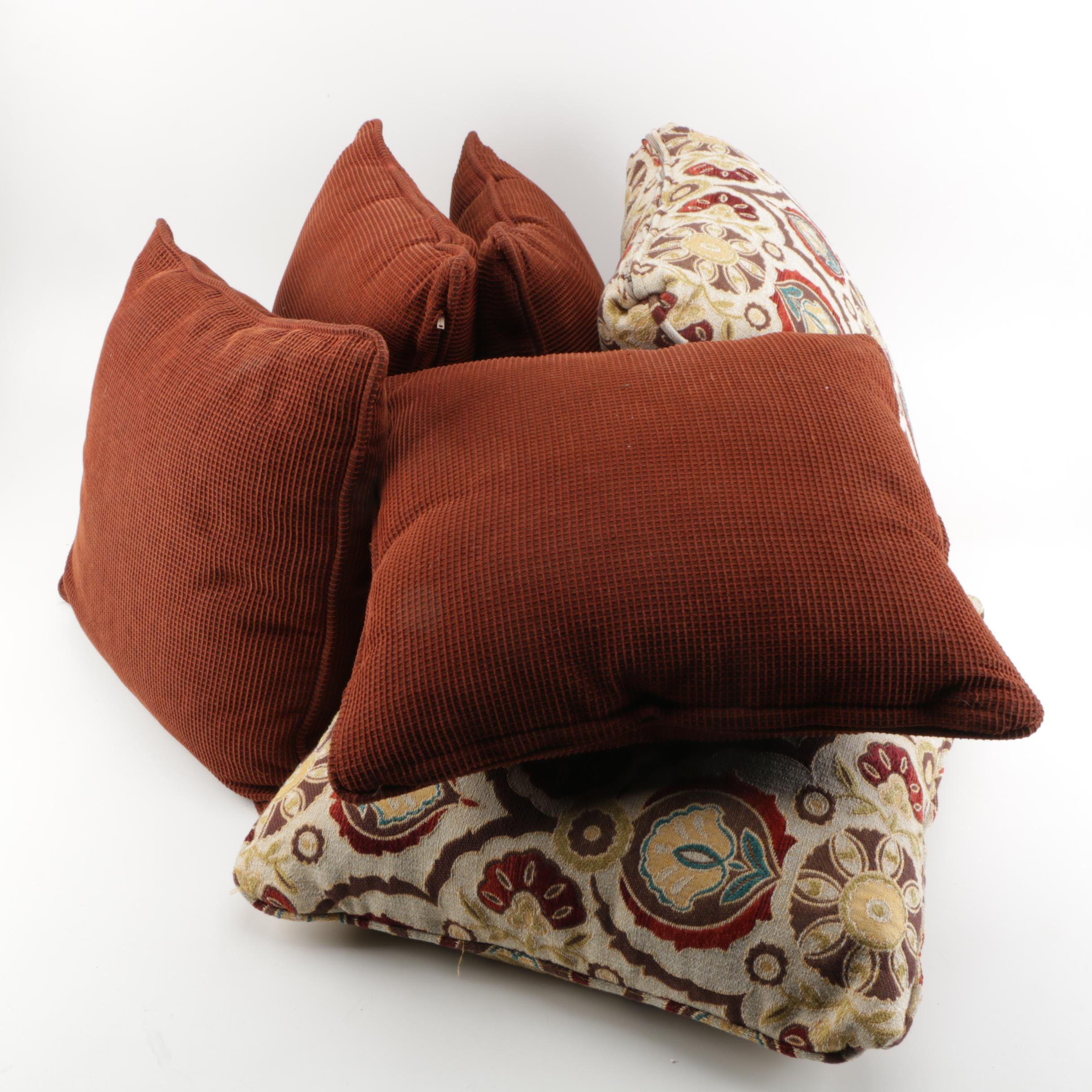 Floral and Rust-Colored Pillows