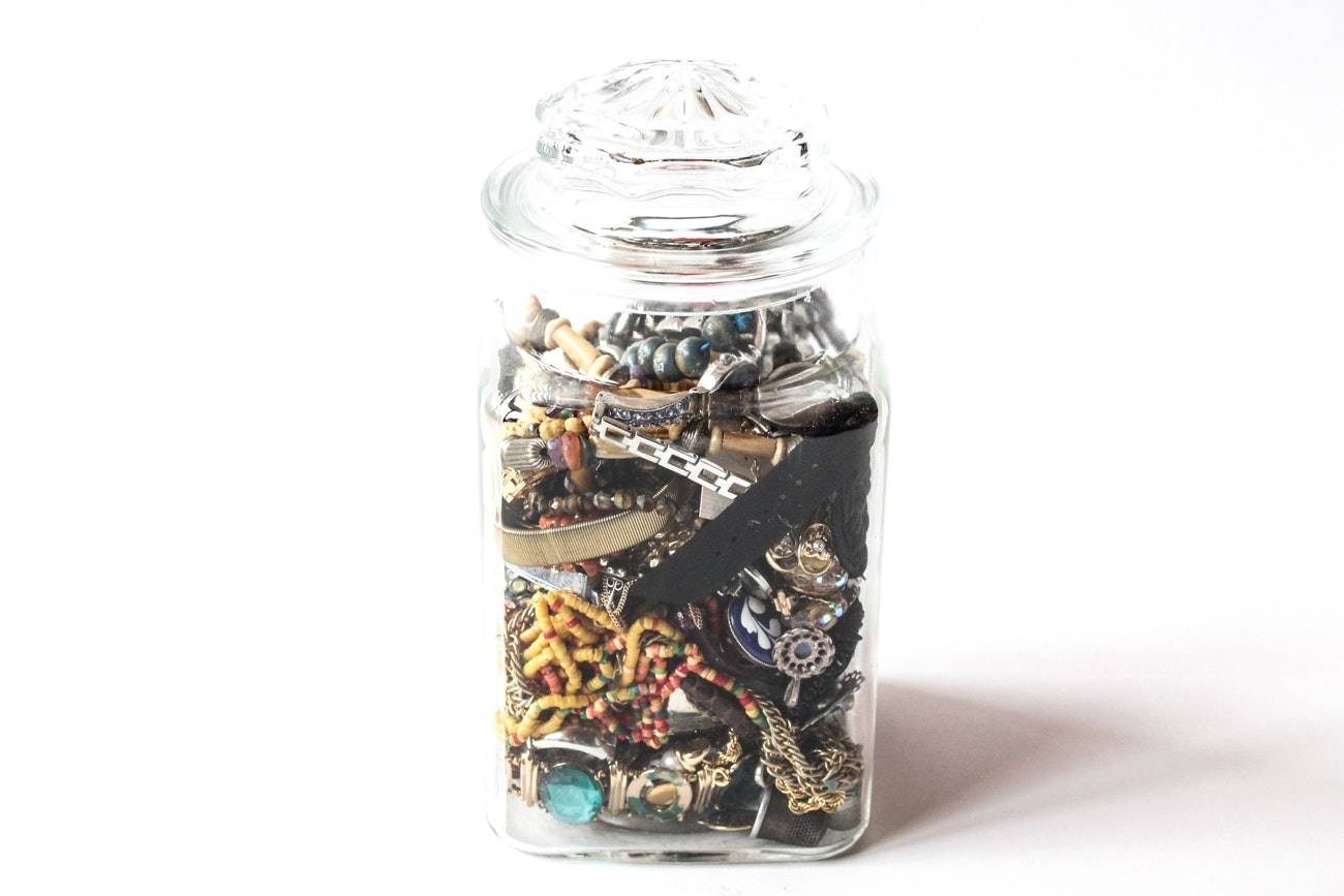 Assorted Jewelry in Glass Canister