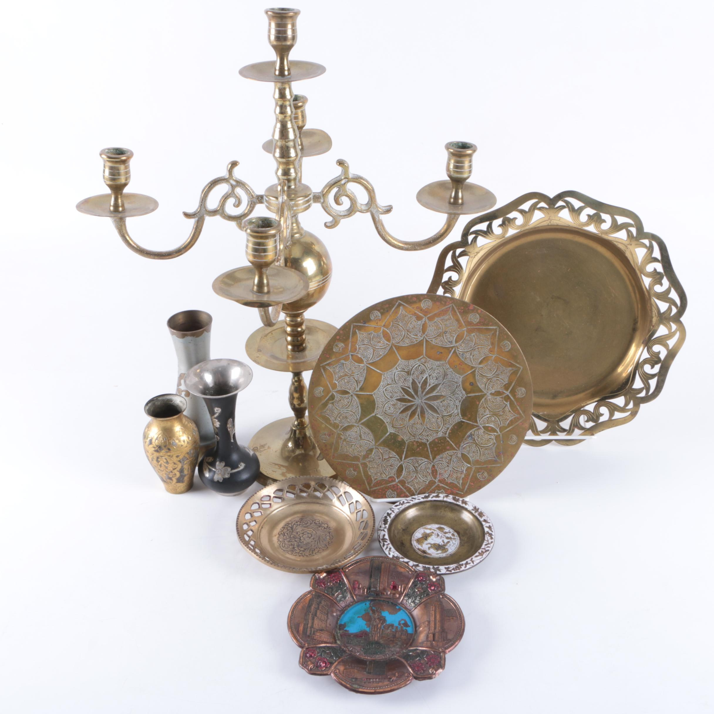 Brass Candelabrum with a Group of Brass-Tone Plates and Vases