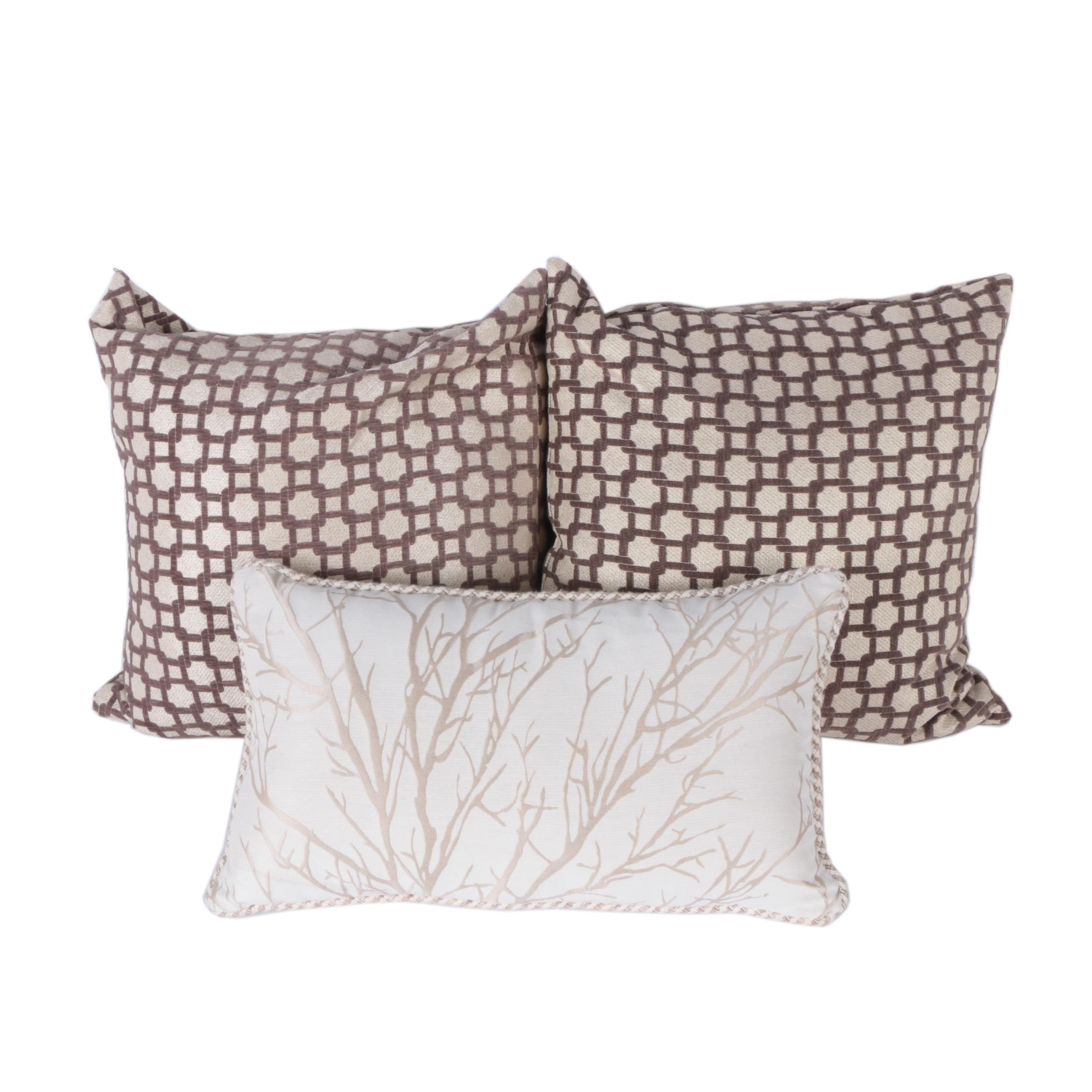 Collection of Three Neutral Toned Decorative Throw Pillows