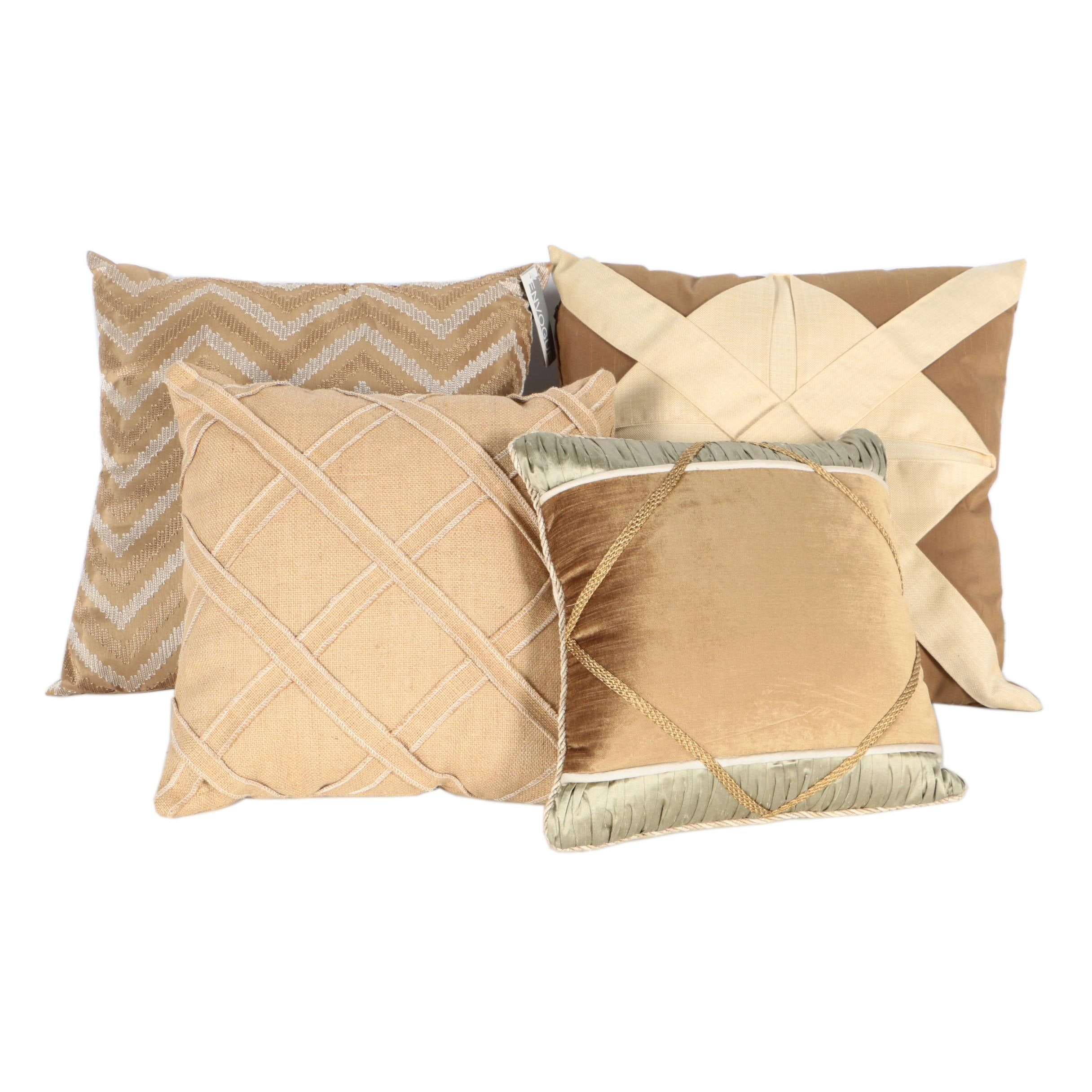 Collection of Four Neutral Hued Decorative Throw Pillows