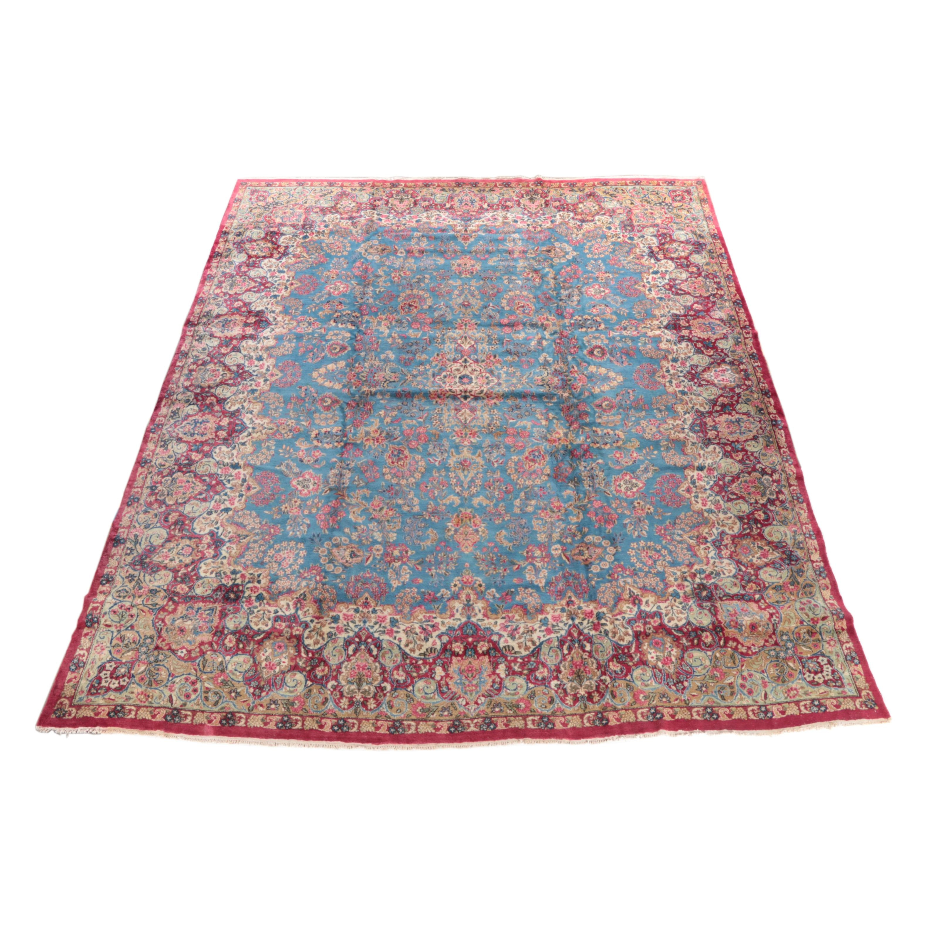 A Hand-Knotted Persian Kerman Wool Area Rug
