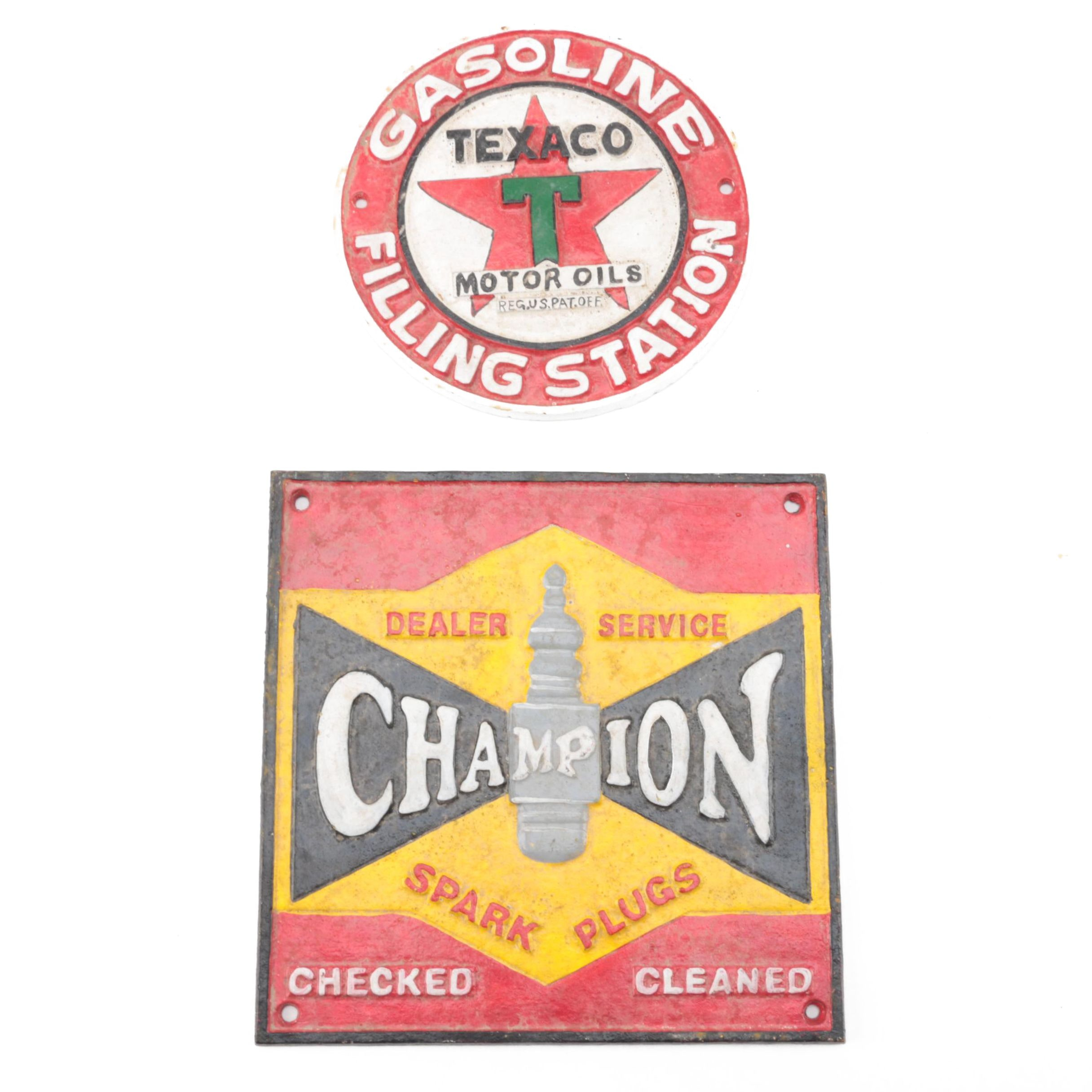 Champion Spark Plugs and Texaco Motor Oil Cast Iron Signs