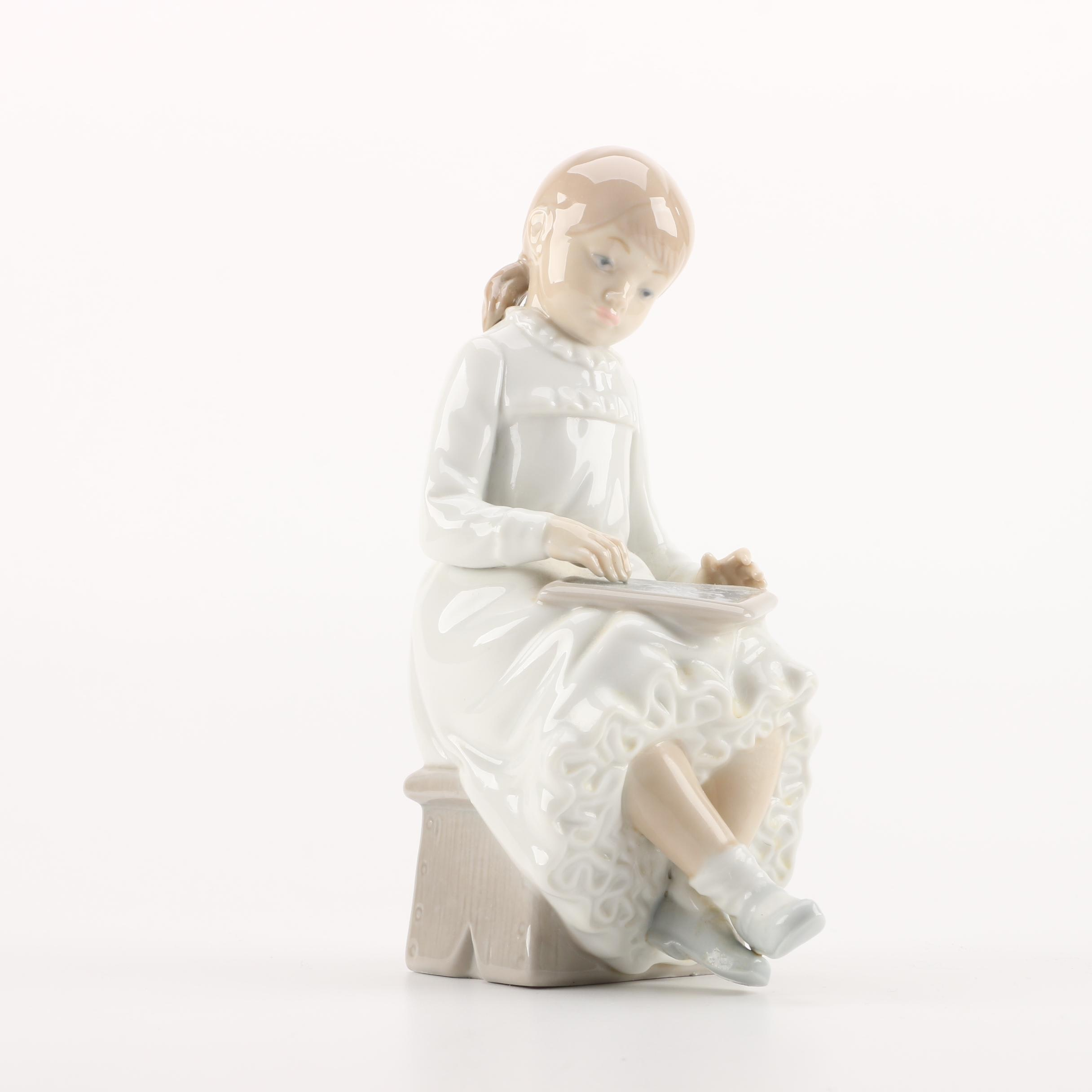 "NAO by Lladró ""Girl Sitting Writing on Chalkboard"" Figurine"