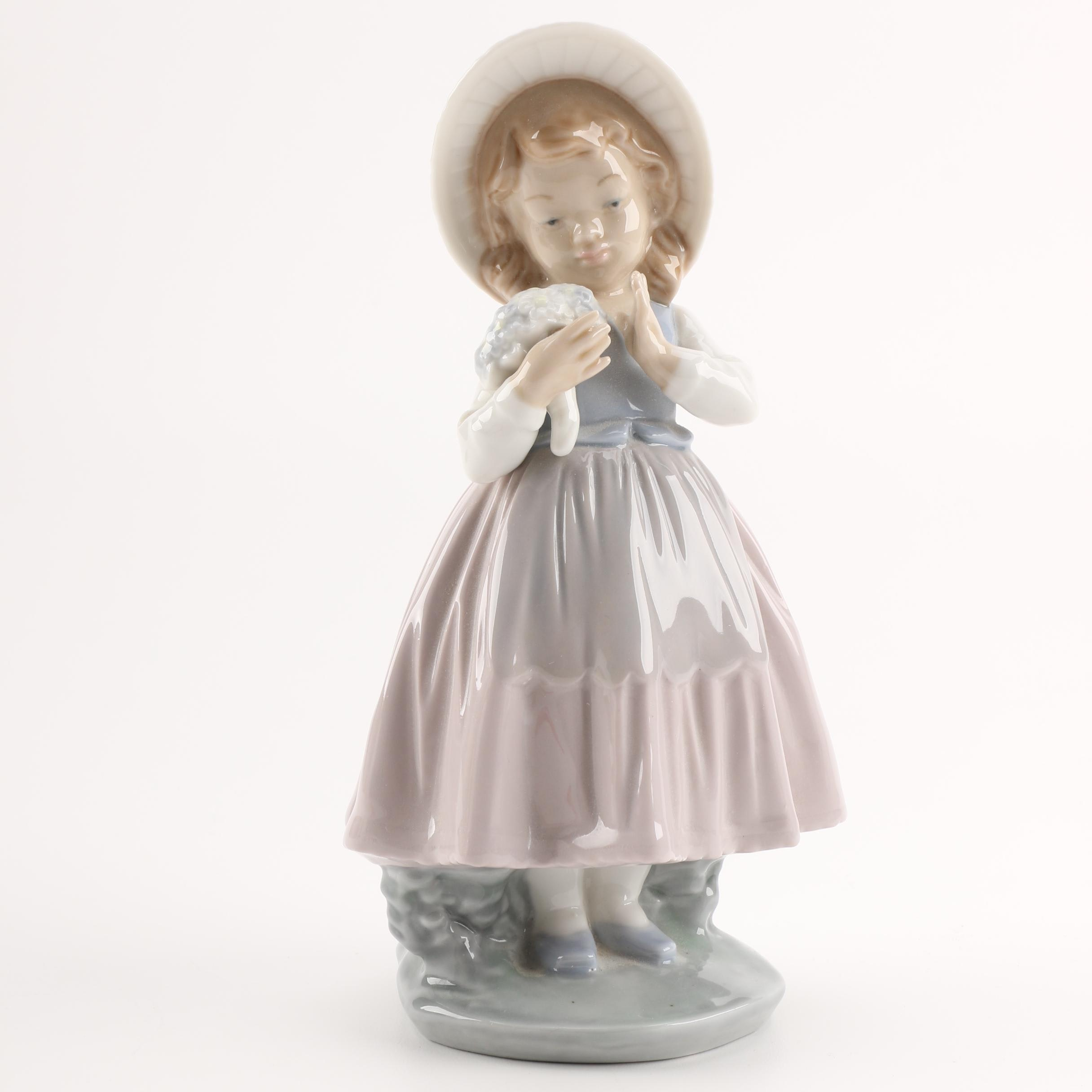 """NAO by Lladró """"Girl Admiring Bouquet"""" Figurine"""