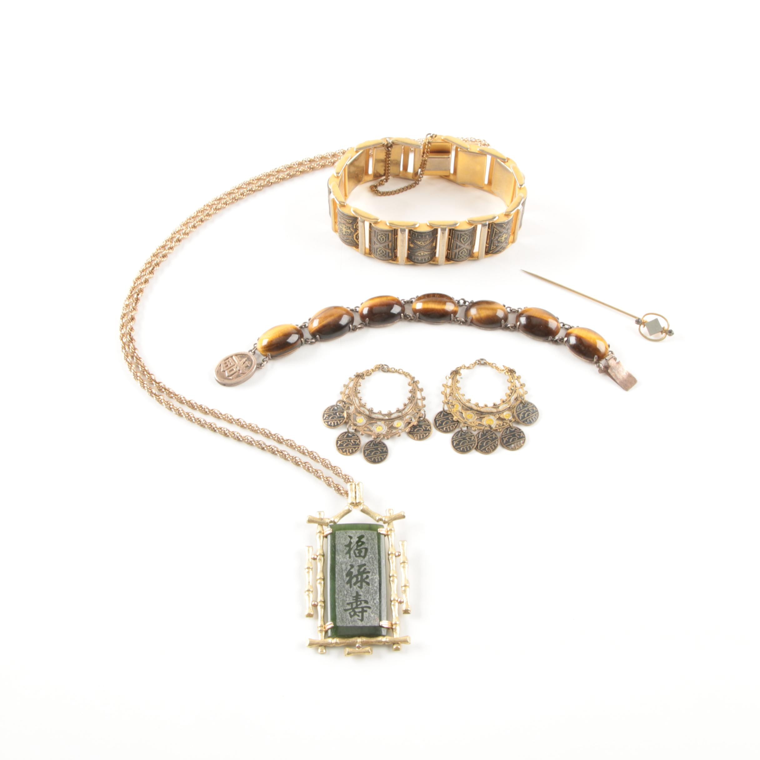 Collection of Gold Toned Jewelry Including a Silver Bracelet