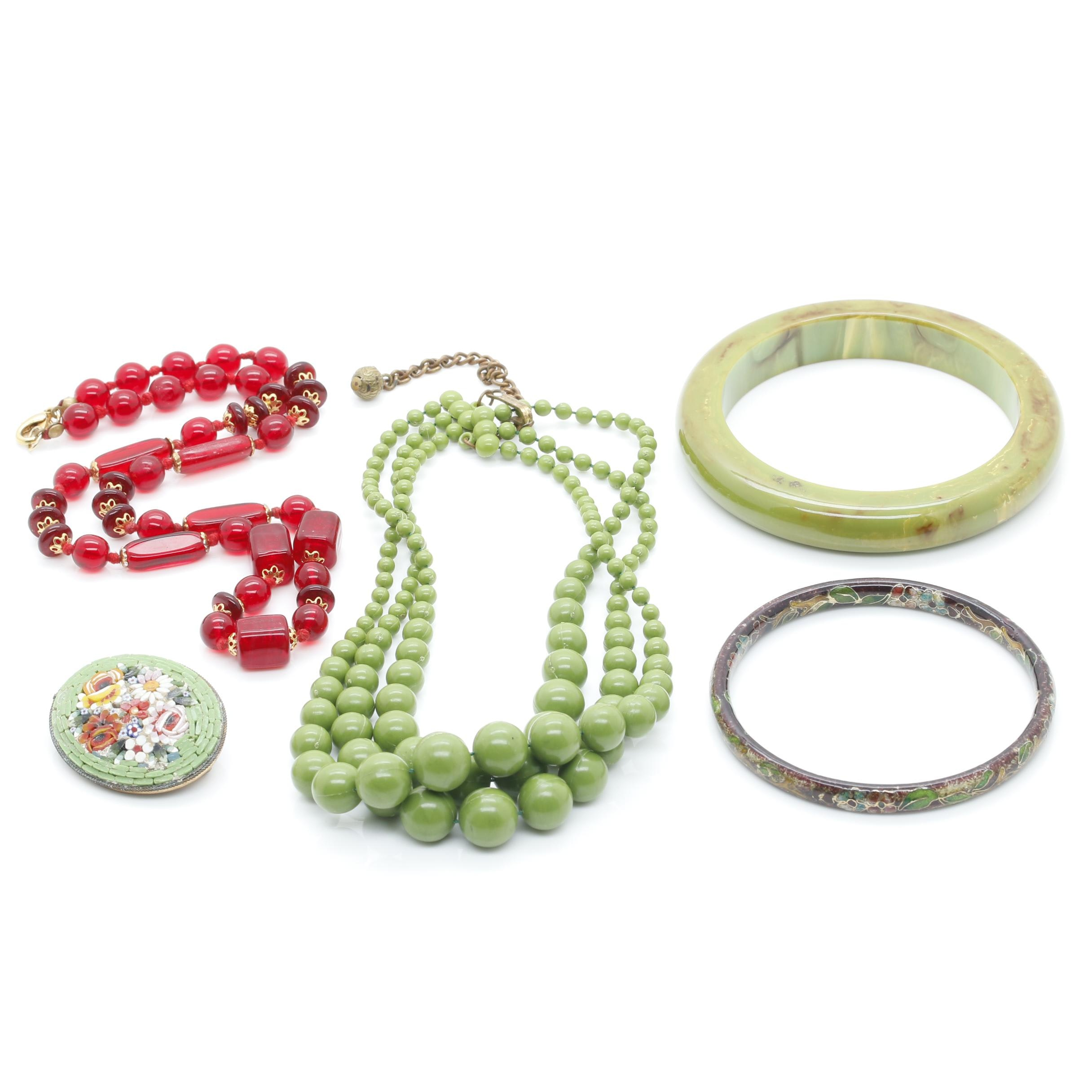 Gold Tone Jewelry Assortment Featuring Bakelite and Glass