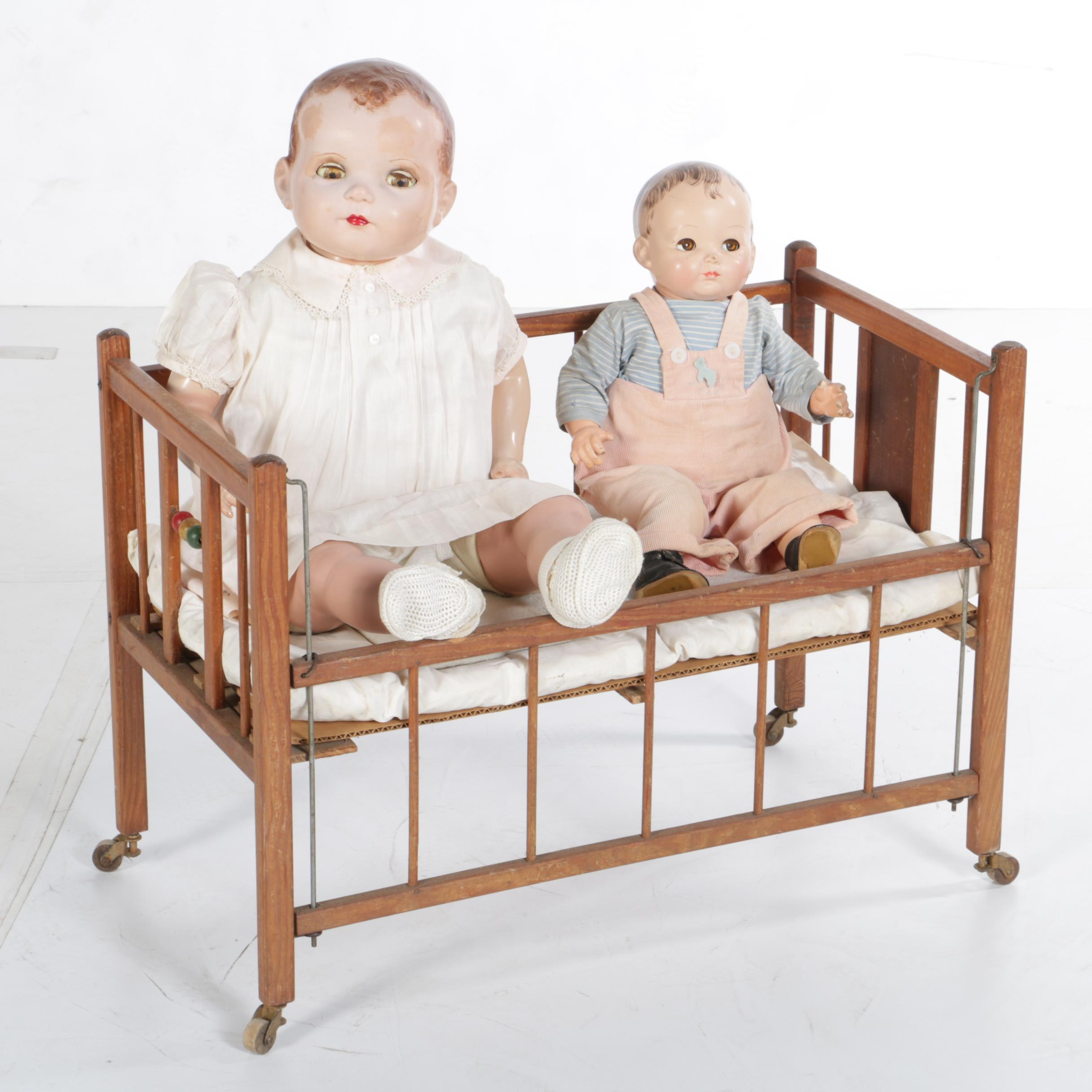 Circa 1950s Composition Baby Dolls with Wooden Toy Crib