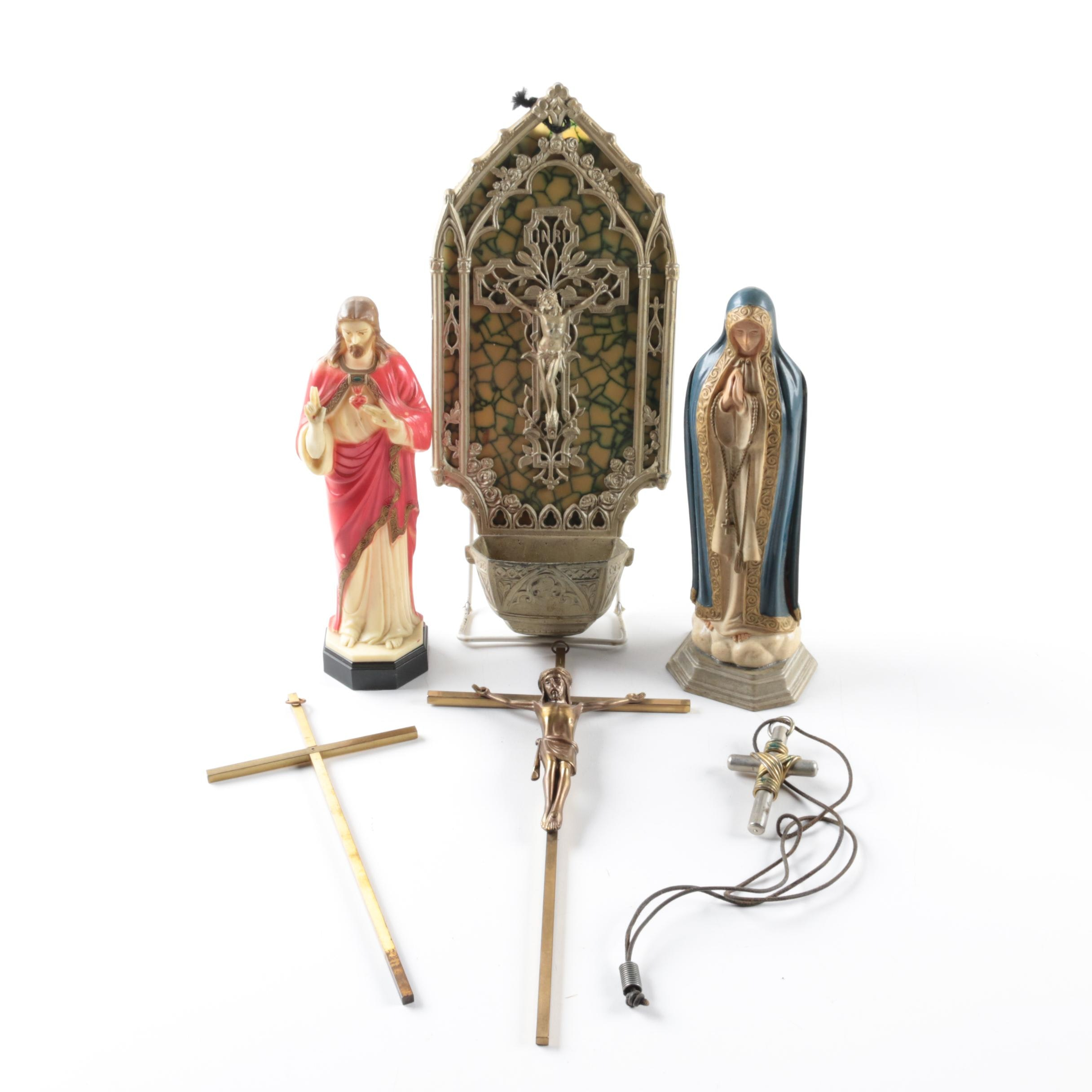 Collection of Christian Crosses, Figurines, and a Font