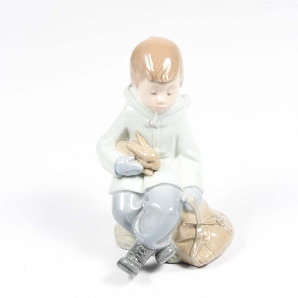 Nao by Lladó Porcelain Figurine of a Boy Holding a Bunny