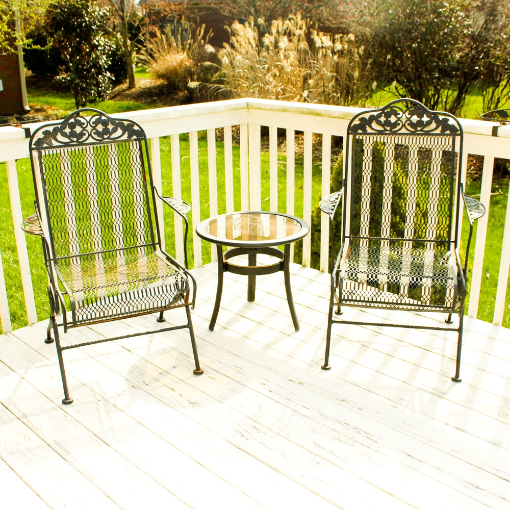 Two Wrought Iron Chairs and Round Table