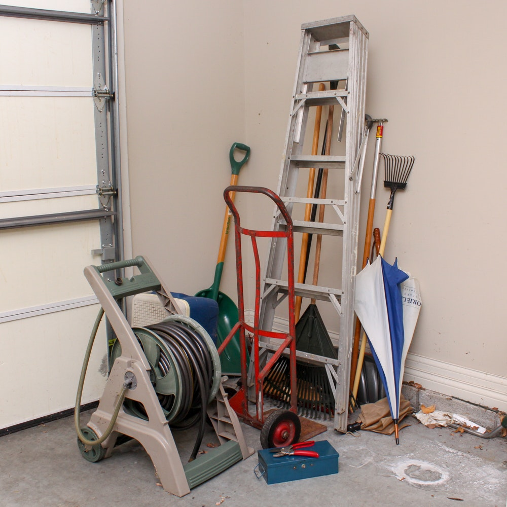 Ladder, Dolly, Cooler, Hose with Reel, Rakes, Shovel, and More Garage Items