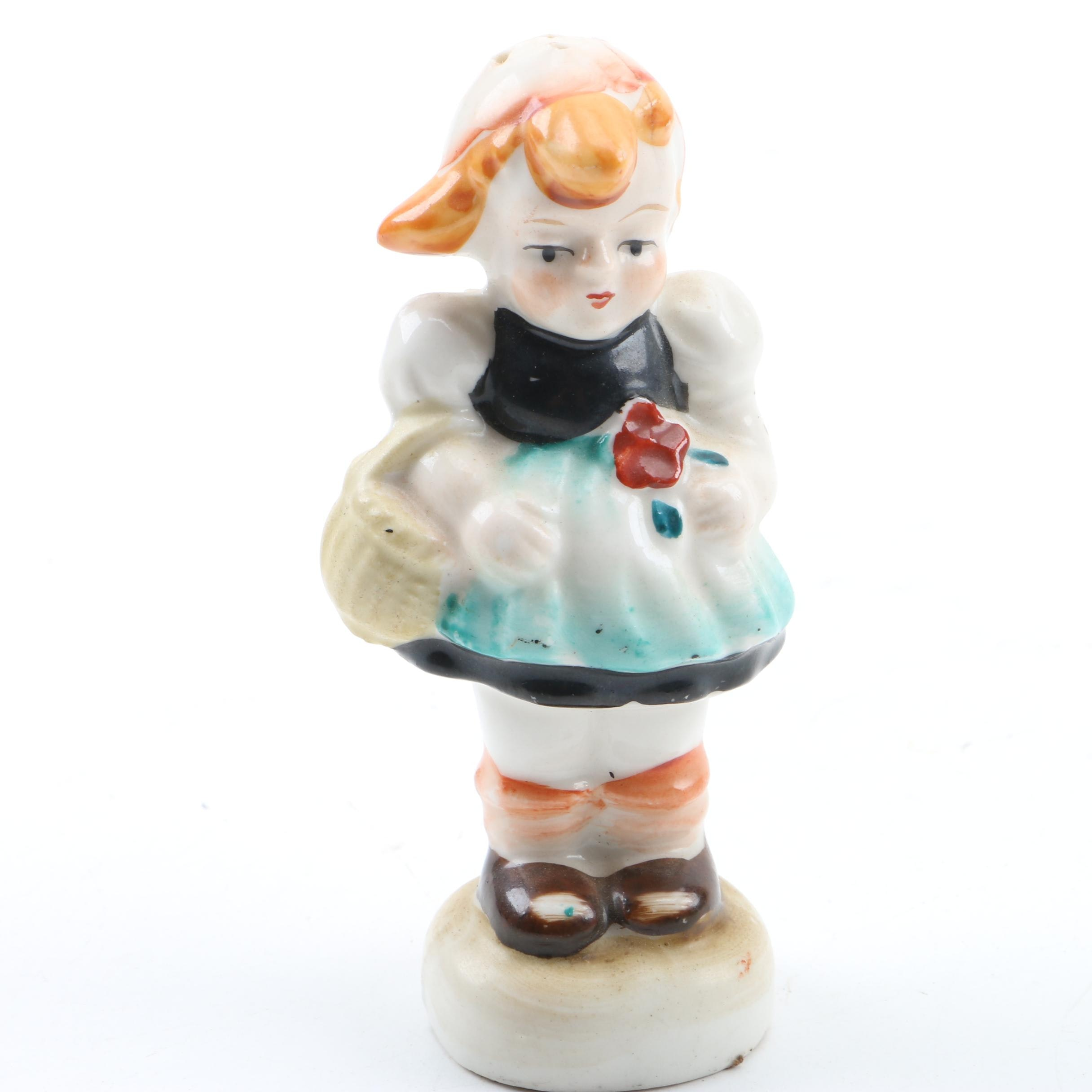 Occupied Japan Salt Shaker of a Girl Carrying a Red Flower