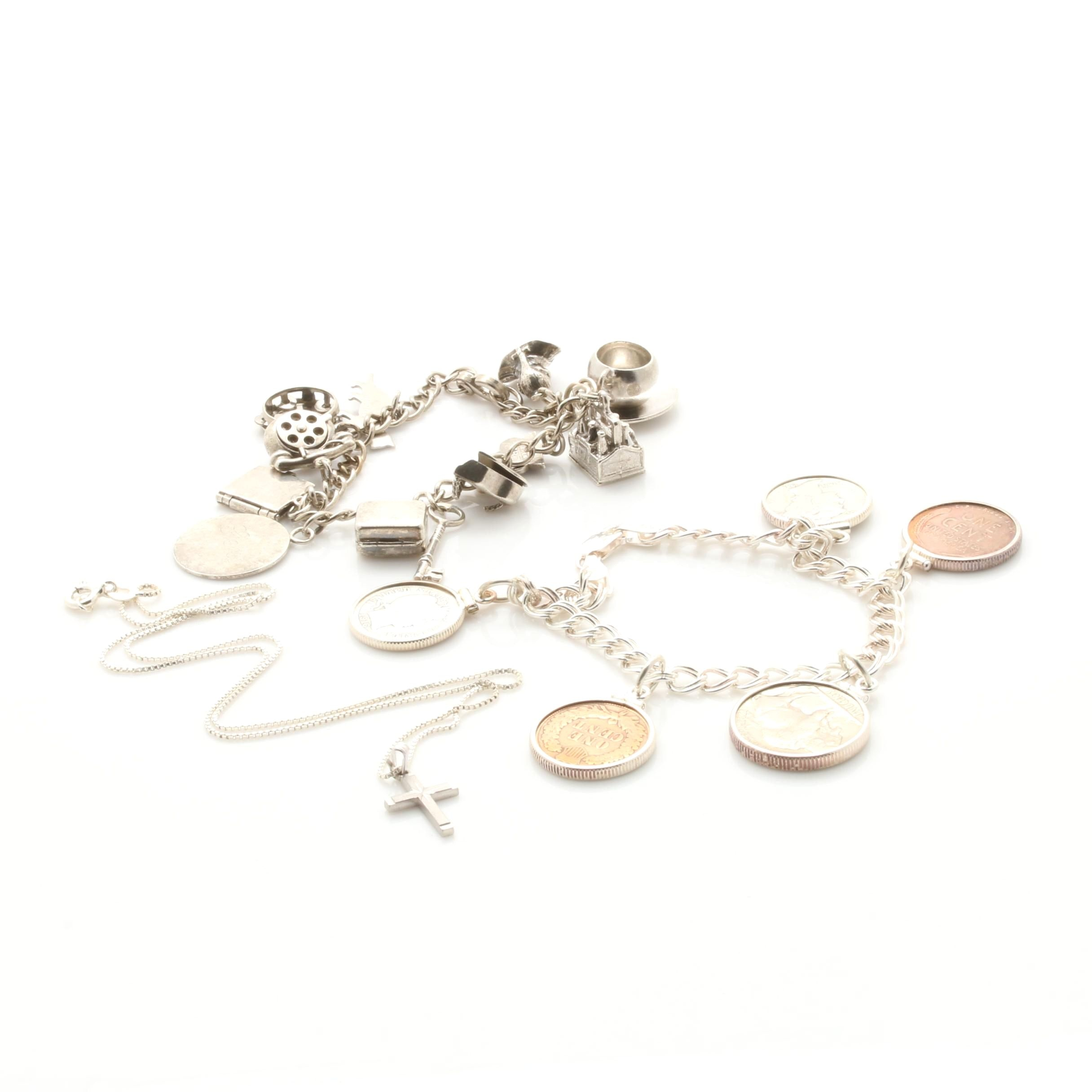 Sterling Silver Jewelry Including Coins, Charms, and a Pendant