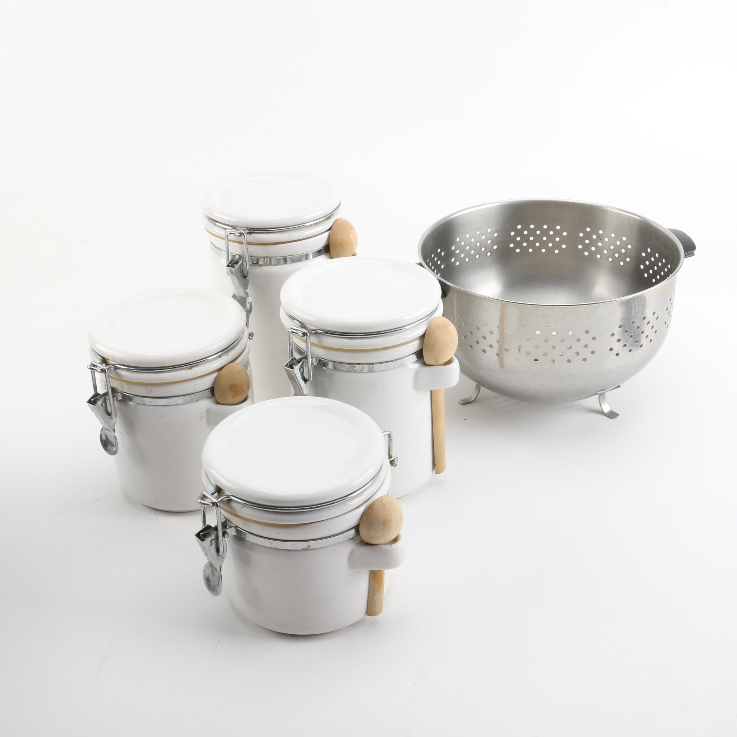 Metal Colander and Ceramic Canisters with Wooden Spoons