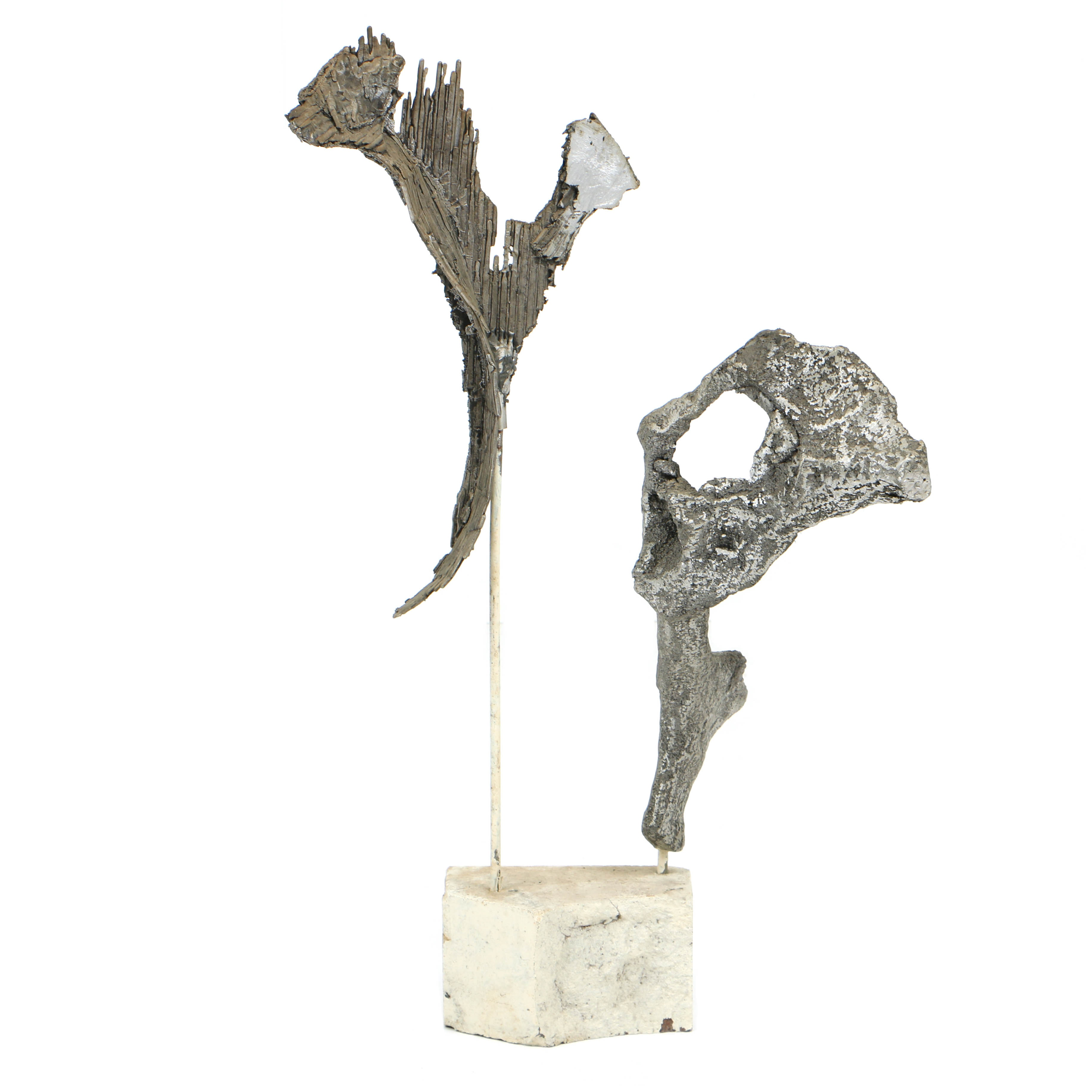 Abstract Metal Sculpture on Stone Base