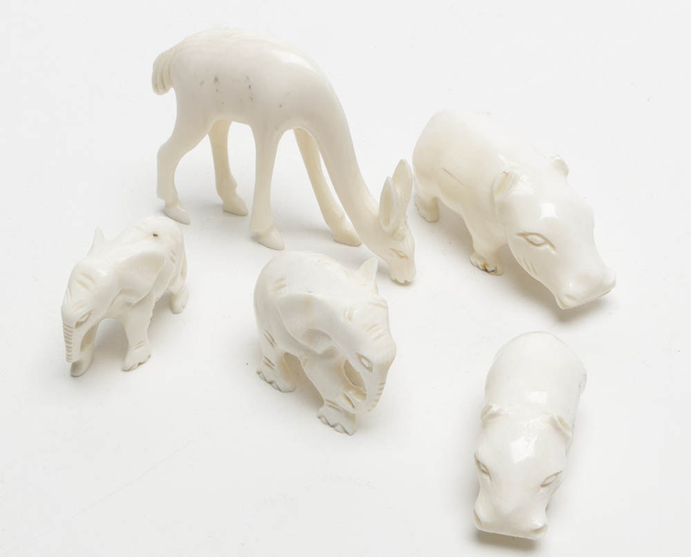 Five white carved animals