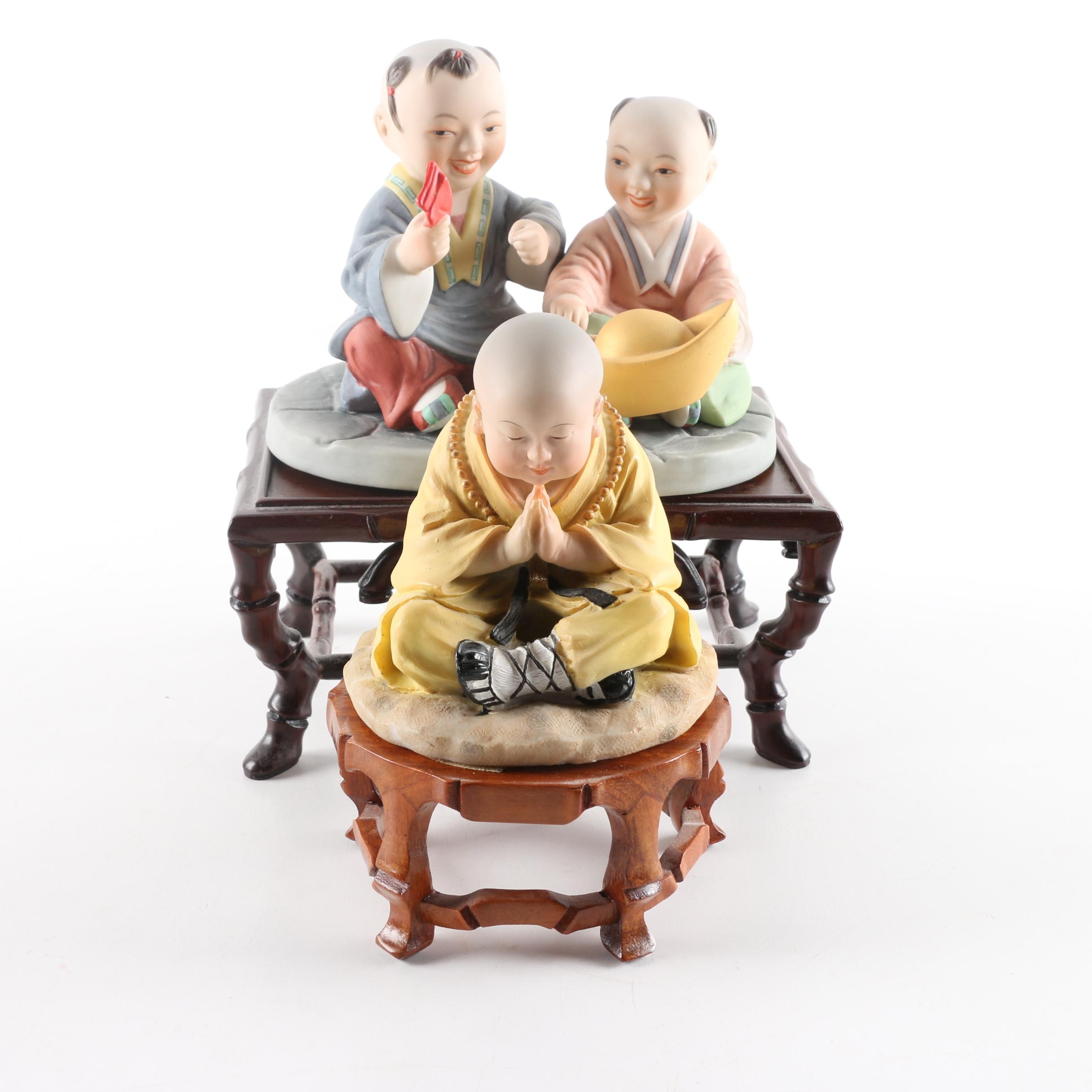 Asian figurine stands